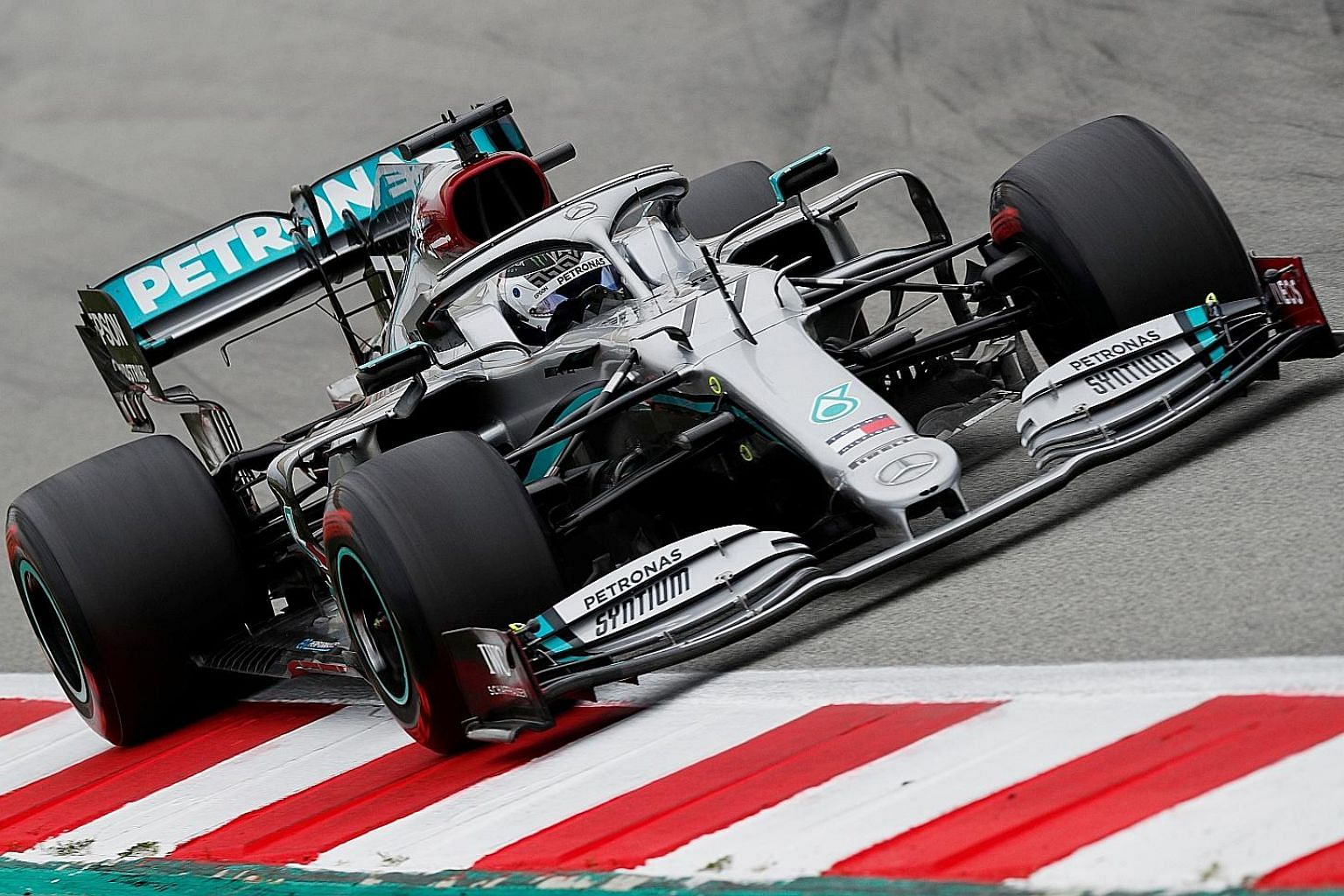 Mercedes' Valtteri Bottas topped all drivers during testing at the Barcelona circuit, installing the winners of the last six drivers' and constructors' titles as favourites in Australia. PHOTO: REUTERS