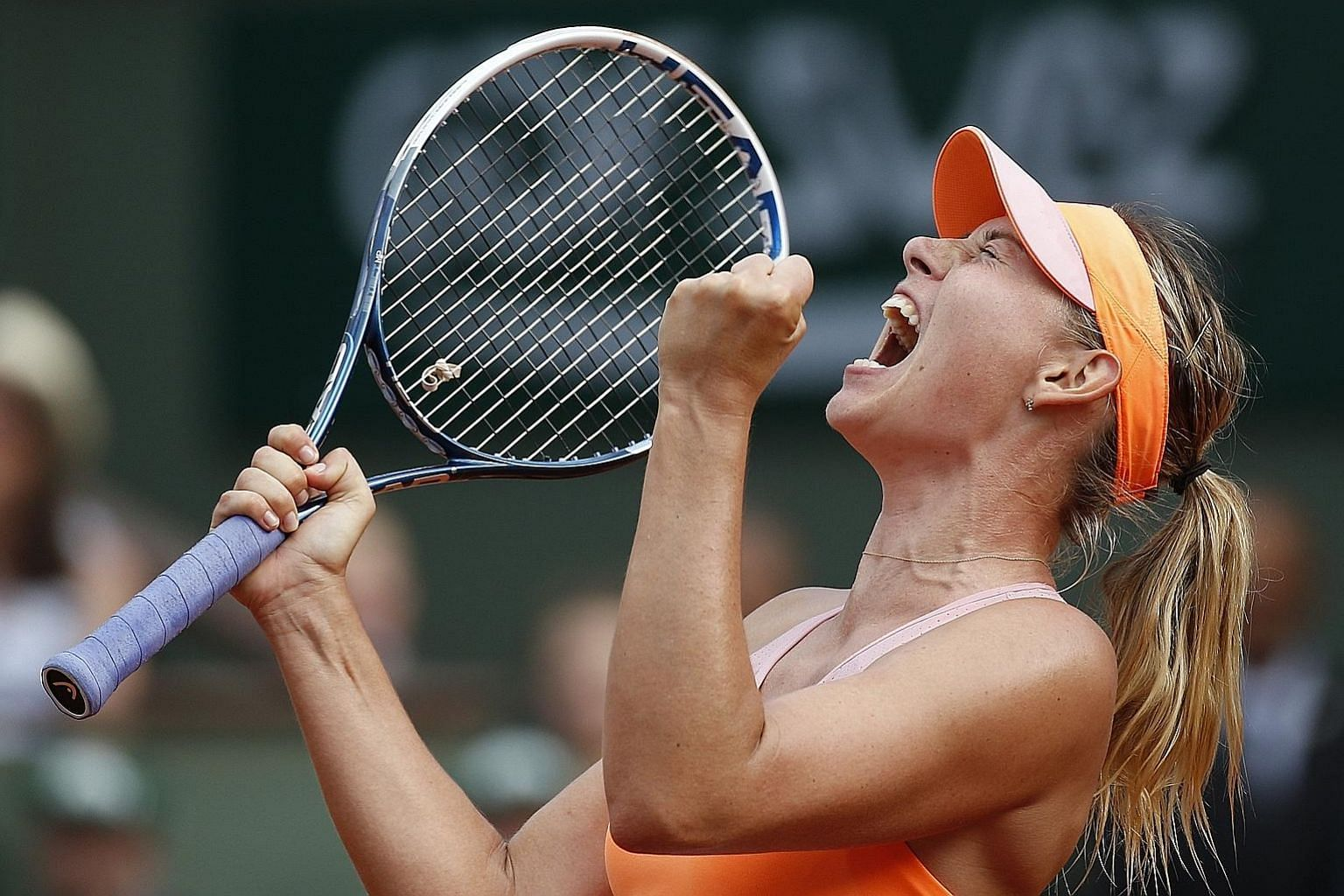 Maria Sharapova celebrating after the 2014 French Open final where she claimed her second Roland Garros title. The now-retired Russian, a five-time Grand Slam champion, is known for her never-say-die attitude. PHOTO: EPA-EFE