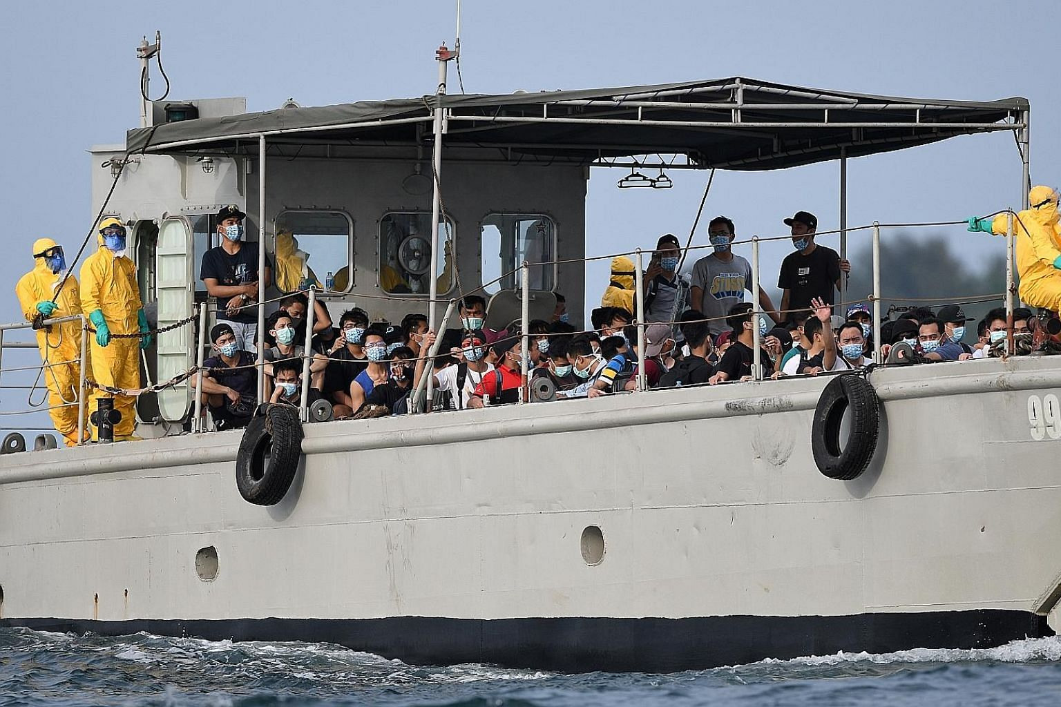Indonesian nationals being transported to Sebaru Kecil Islands, north of Jakarta's coast, for observation last Saturday after being evacuated from the World Dream cruise liner. They were crew members of the ship, which carried three Chinese nationals