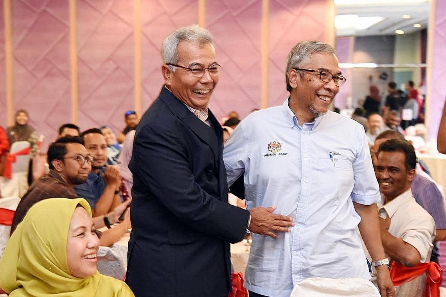 Former entrepreneur development minister Redzuan Yusof (left) and his former deputy minister Hatta Ramli at a ministry function last Thursday that was also attended by a confirmed coronavirus patient.