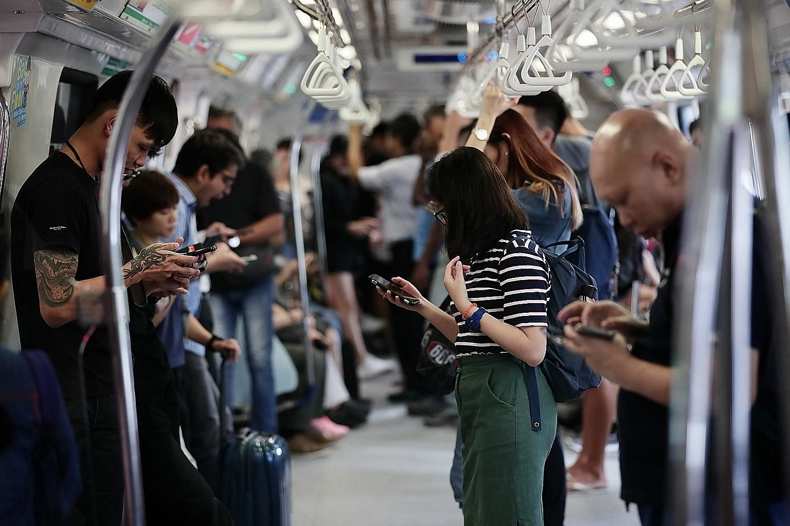 """By April 15, all overseas calls will come with the """"+"""" prefix to help the users of mobile phone lines better identify possible scams. Overseas-based scammers sometimes spoof calls to look like local numbers, said Senior Minister of State for Communic"""