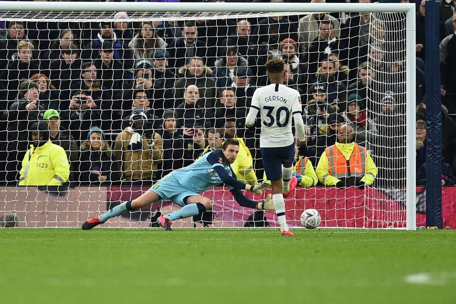 Norwich goalkeeper Tim Krul saving a spot kick from Gedson Fernandes, Tottenham's third miss in the shoot-out, to earn a 3-2 win for the Premier League's bottom club. The Canaries will face the winners of the tie between Derby and Manchester United i