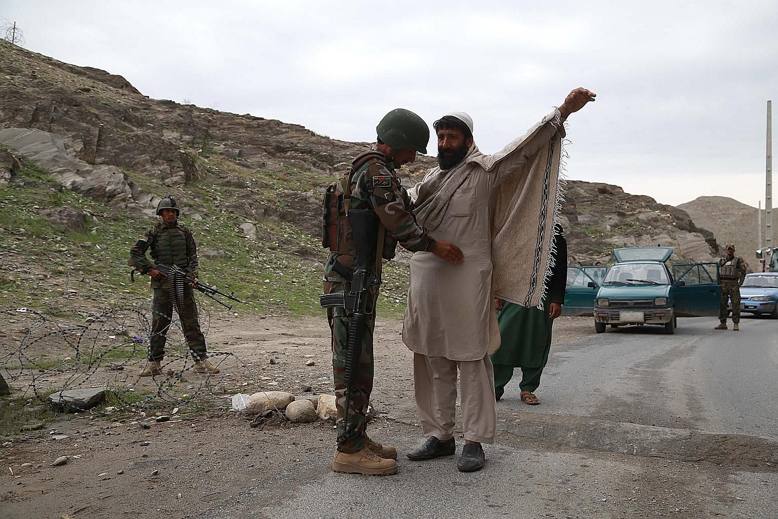 Afghan security officials manning a checkpoint in Nangarhar province, Afghanistan, on Wednesday. The US and Taleban signed a peace agreement on Feb 29, whereby the Americans will begin withdrawing some of their troops.