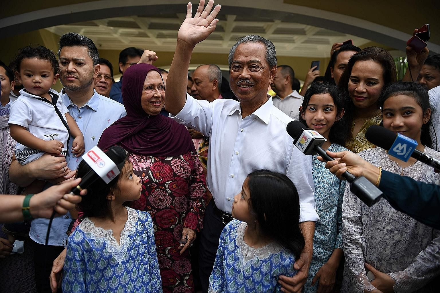 Tan Sri Muhyiddin Yassin and his family outside his home in Kuala Lumpur on Feb 29, after royal officials had named him Malaysia's eighth prime minister. Few observers would have predicted that Mr Muhyiddin would seize the premiership from household