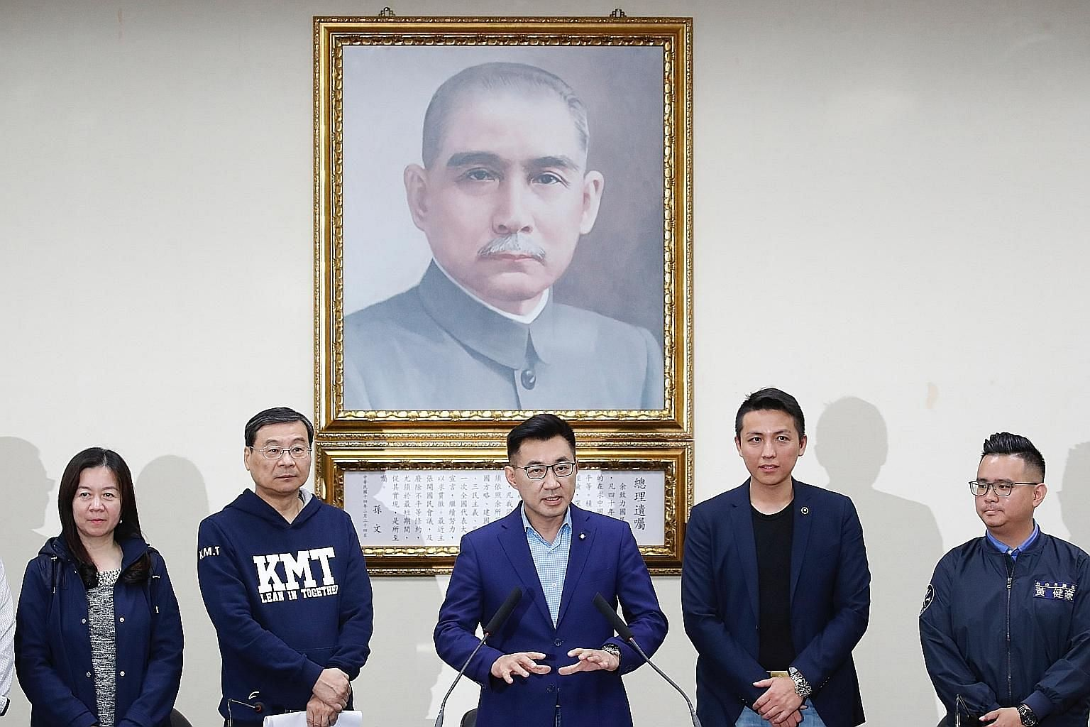 Newly elected Kuomintang chairman Chiang Chi-chen speaking after the party's election in Taipei yesterday. The party's Central Standing Committee had also resigned over the general election defeat in January, and 32 new members were elected yesterday