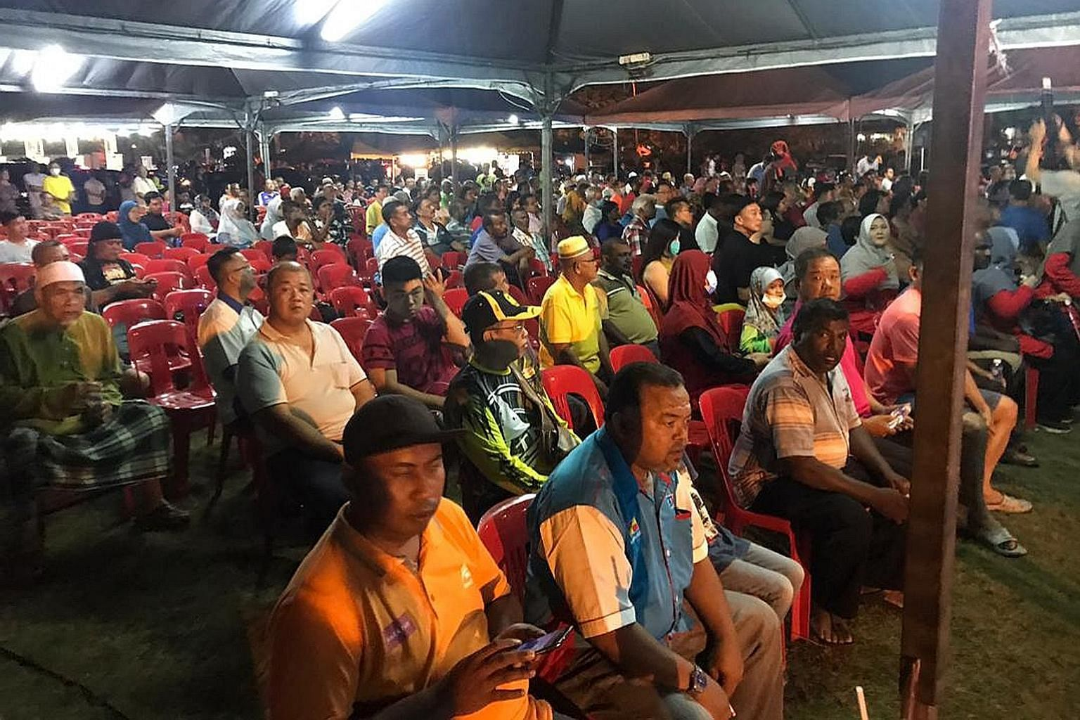 "People attending Pakatan Harapan's roadshow in Taman Sri Andalas, Klang, last night. The spirited speeches by PH leaders were peppered with cries of betrayal and corruption, and criticism of the ""backdoor government""."