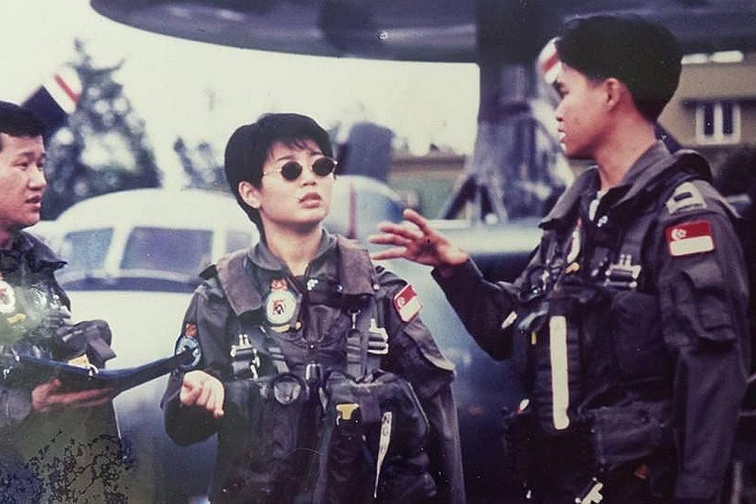 Ms Doris Ng in her earlier days (above) in the Republic of Singapore Air Force, where she was the first woman selected to join the aircrew of the E-2C Hawkeye aircraft. Ms Ng (left), who later joined the Singapore Prison Service, is now executive dir