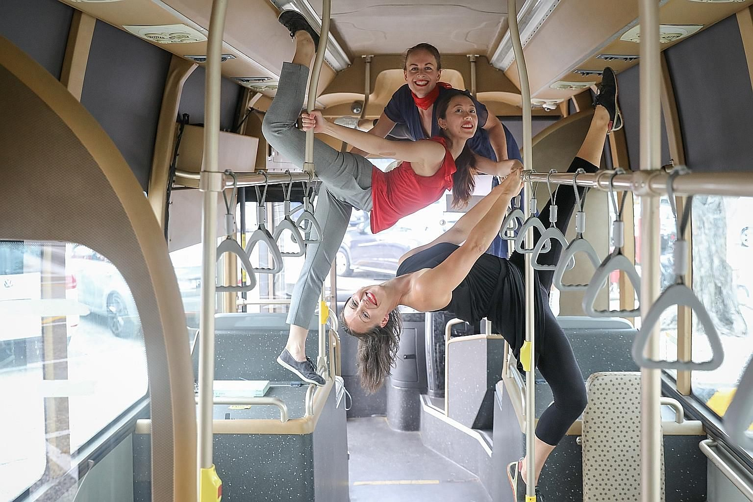 (From top) Dancers Lauren Carr, Adele Goh and Sacha Copland will perform in Back Of The Bus, part of the Arts In Your Neighbourhood series. ST PHOTO: ONG WEE JIN