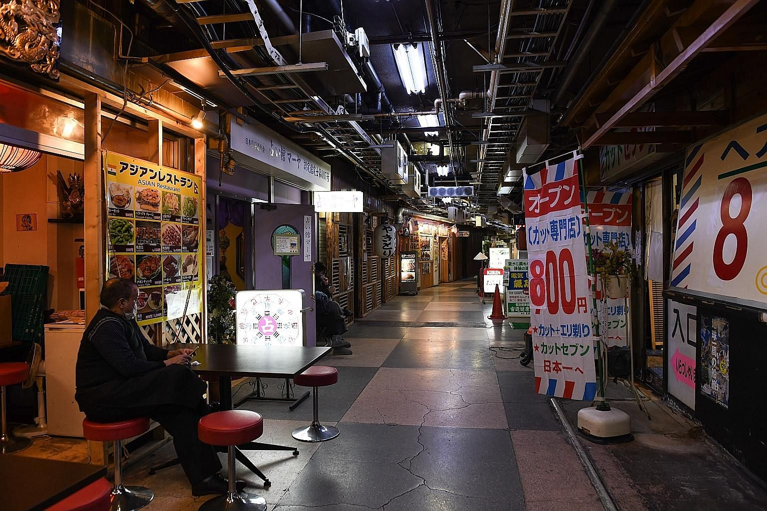 An empty underground shopping centre in Tokyo's Asakusa district on Sunday. The worse-than-expected gross domestic product data showed that the economy was already in a highly fragile state when the virus started to knock back exports, supply chains,
