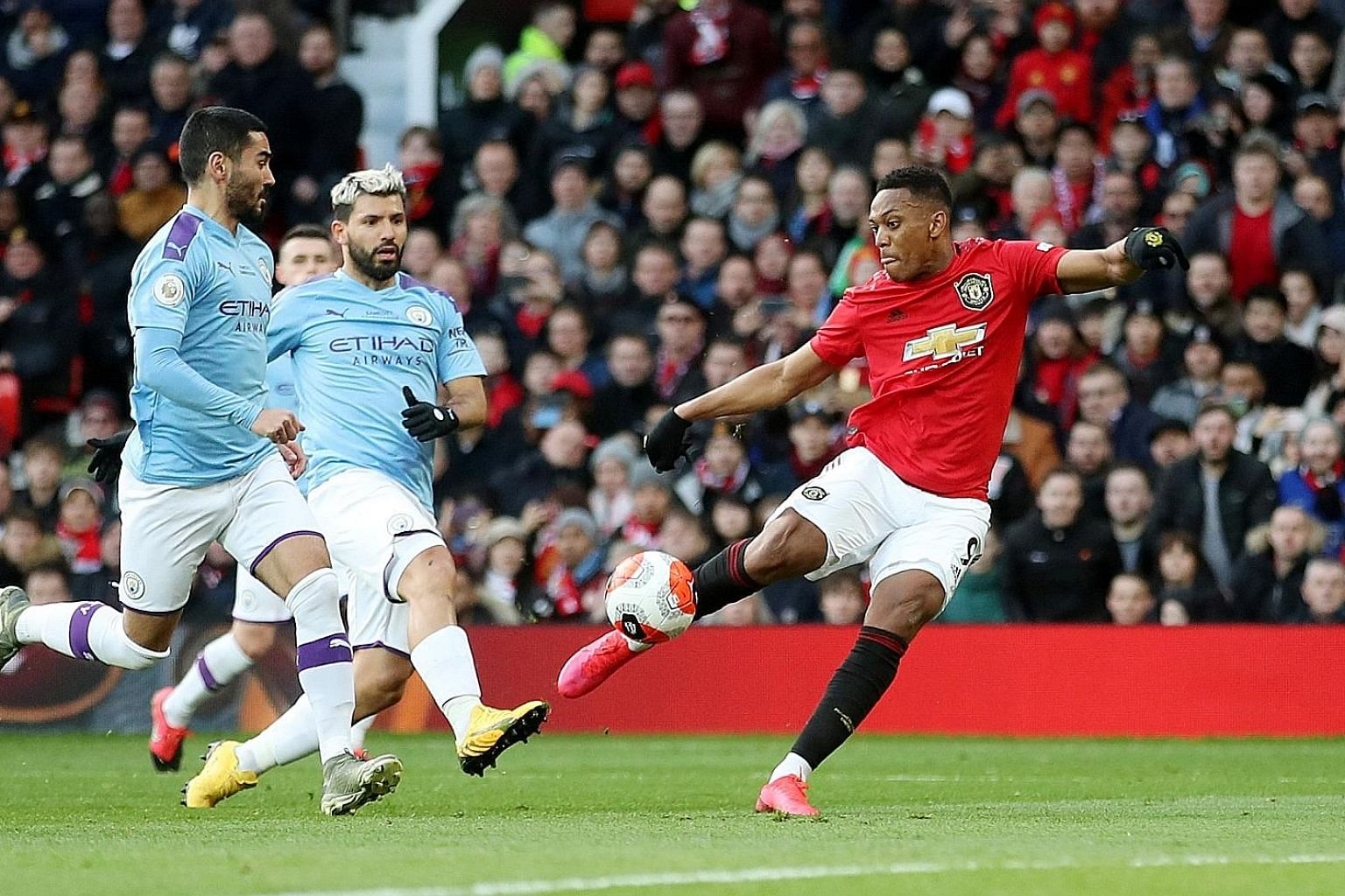 Anthony Martial scoring off Bruno Fernandes' inventive free kick, although his strike was also fumbled by Manchester City's Ederson. PHOTO: REUTERS