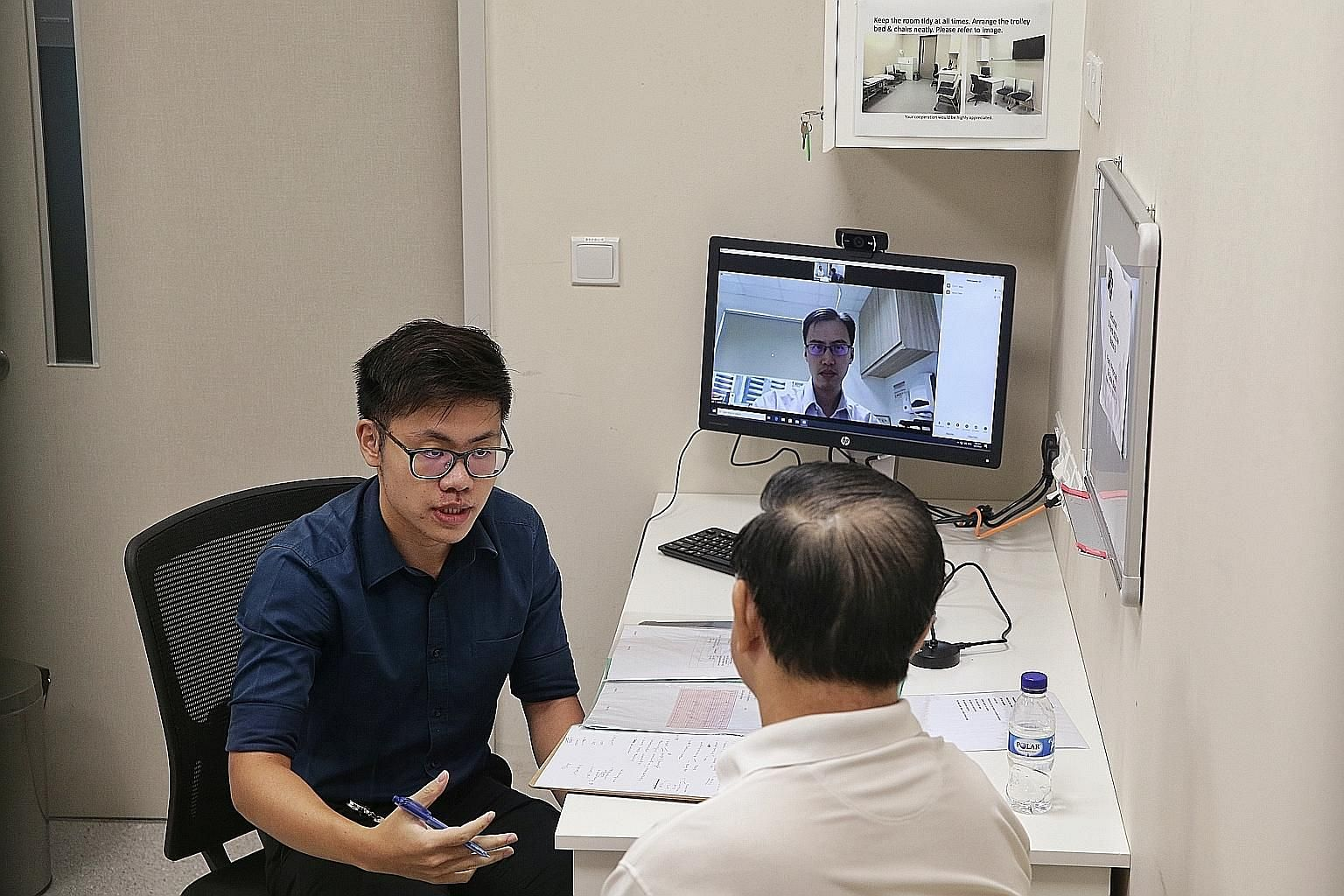 Lee Kong Chian School of Medicine Year 5 student Stanley Low talking to a patient-actor during a simulated consultation yesterday.