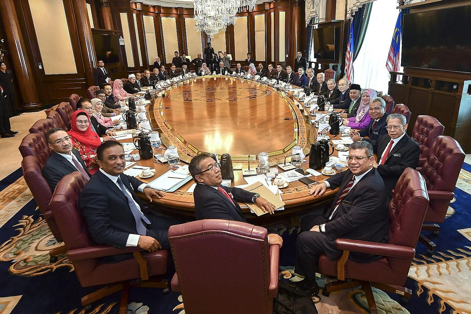 Malaysian Prime Minister Muhyiddin Yassin and his Cabinet ministers, who were sworn in on Tuesday, attending their first meeting yesterday. Mr Muhyiddin, who has appointed four senior ministers instead of a deputy premier, has pledged that his new Ca