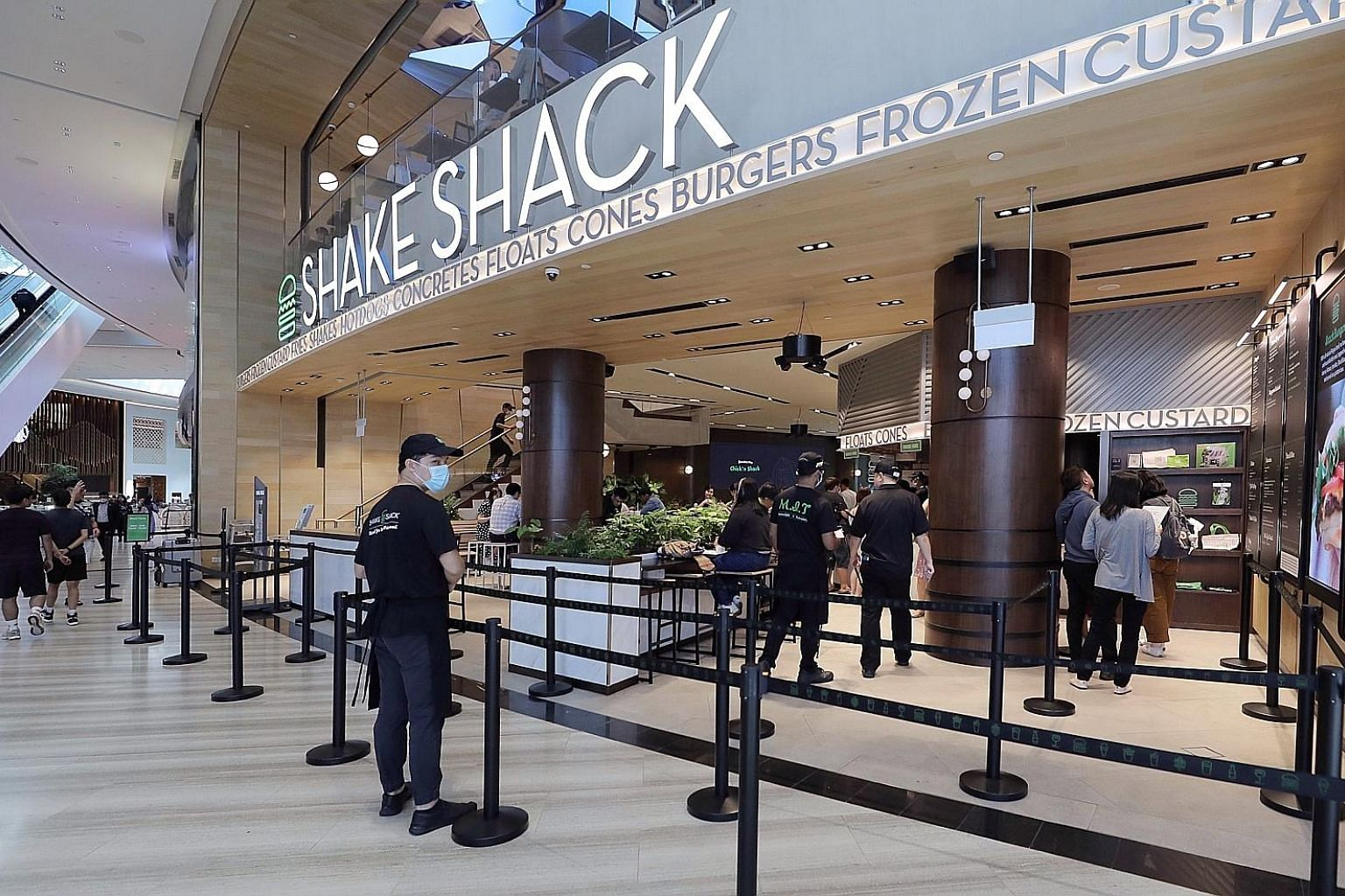 The near-empty queueing area at the Shake Shack burger outlet at Jewel Changi Airport last month. Fears about the coronavirus outbreak have prompted many people to stay away from crowded public places, and food businesses have taken a huge hit. Econo