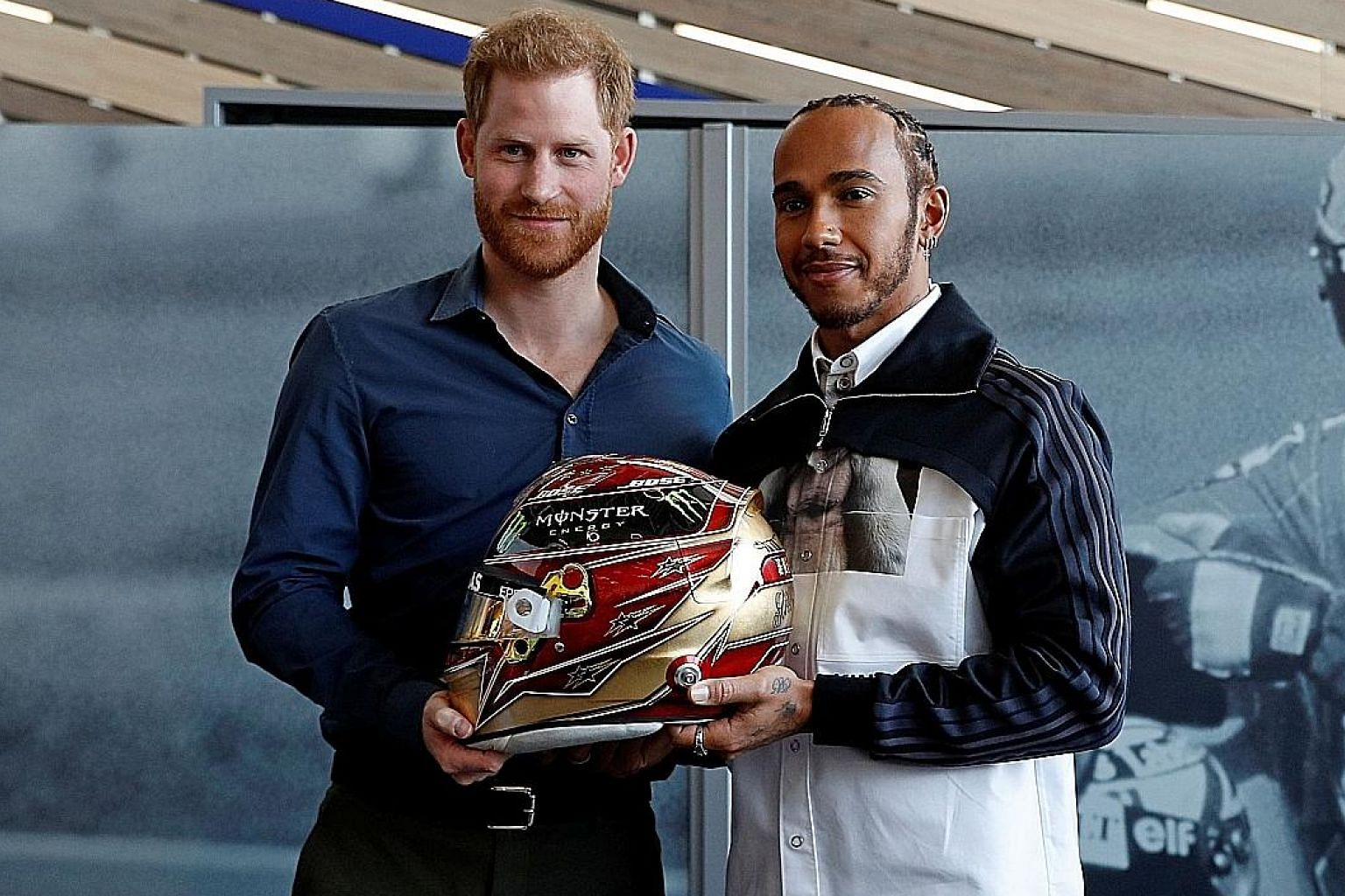 Britain's Prince Harry and Mercedes' F1 world champion driver Lewis Hamilton during the official opening of Silverstone Experience, the British motor racing museum, last Friday. PHOTO: AGENCE FRANCE-PRESSE