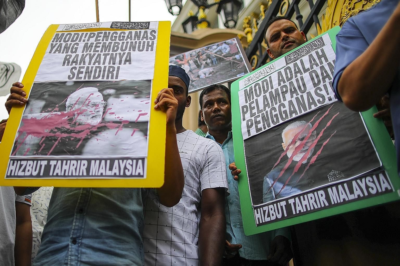 Demonstrators with placards calling for an end to violence against the Muslim community in India, outside India's High Commission in Kuala Lumpur, Malaysia, last week. Large parts of India's capital New Delhi erupted in violence between Hindus and Mu