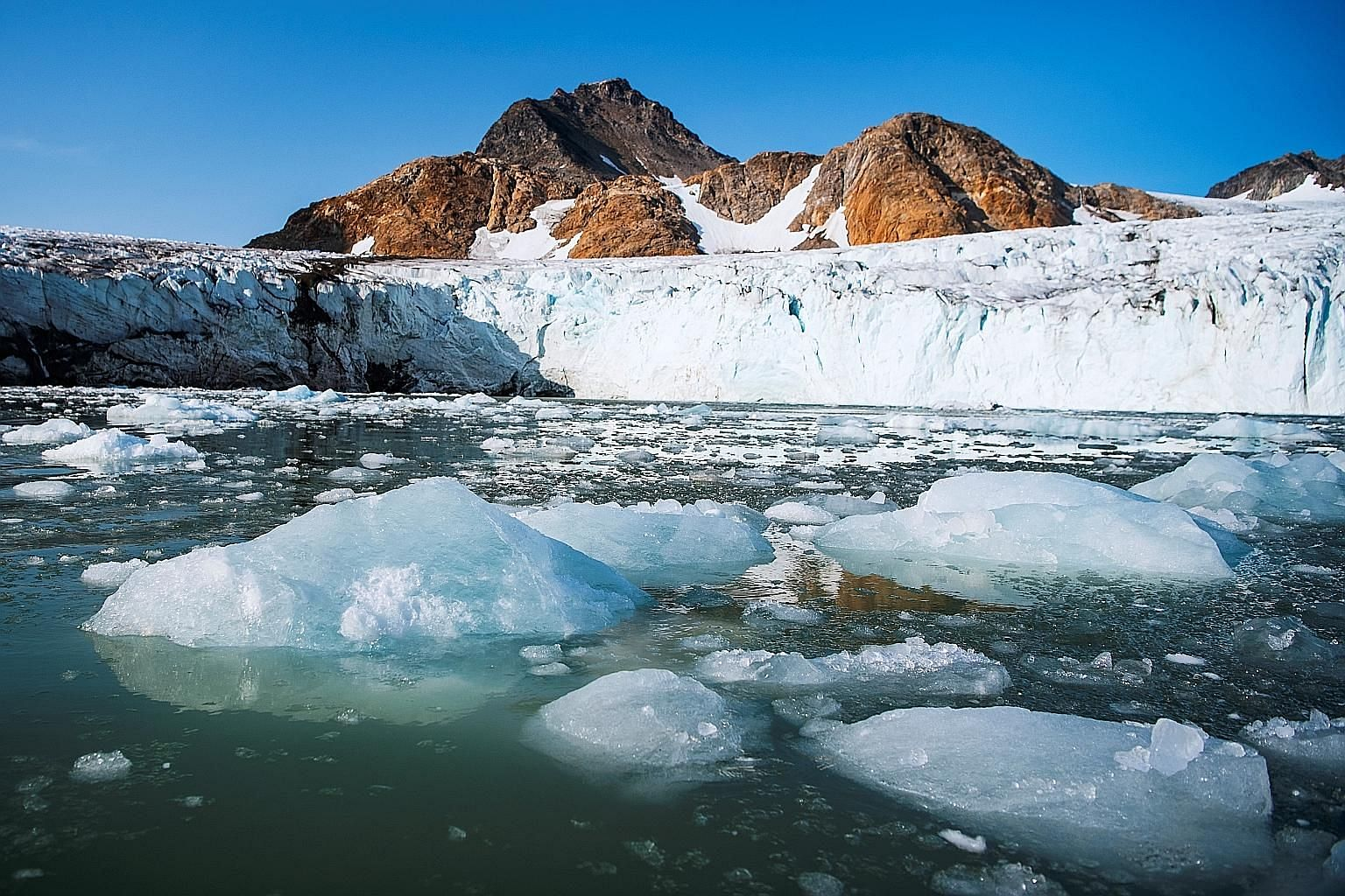 The Apusiajik glacier on the south-eastern shore of Greenland. The rapid melting of the Greenland ice sheet has been dumping huge amounts of freshwater into the far North Atlantic, reducing the amount of cold, salty water sinking to the depths, there