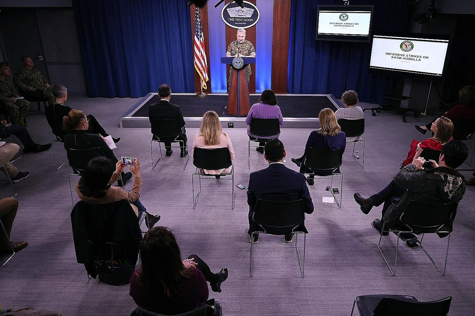 US Marine Corps General Kenneth McKenzie speaking during a news briefing at the Pentagon last Friday. In an example of exercising social distancing to keep the threat of Covid-19 transmission at bay, reporters' chairs were placed a metre apart from o