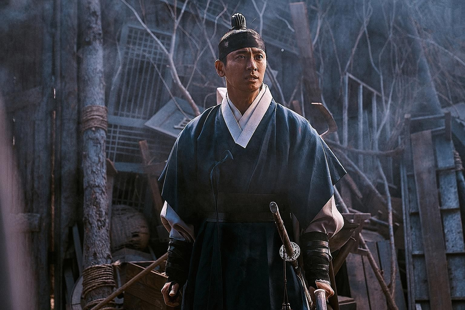 In the South Korean series Kingdom, actor Ju Ji-hoon (above) plays Lee Chang, a righteous prince, and actress Bae Doo-na as a physician caught in the middle of a zombie outbreak.