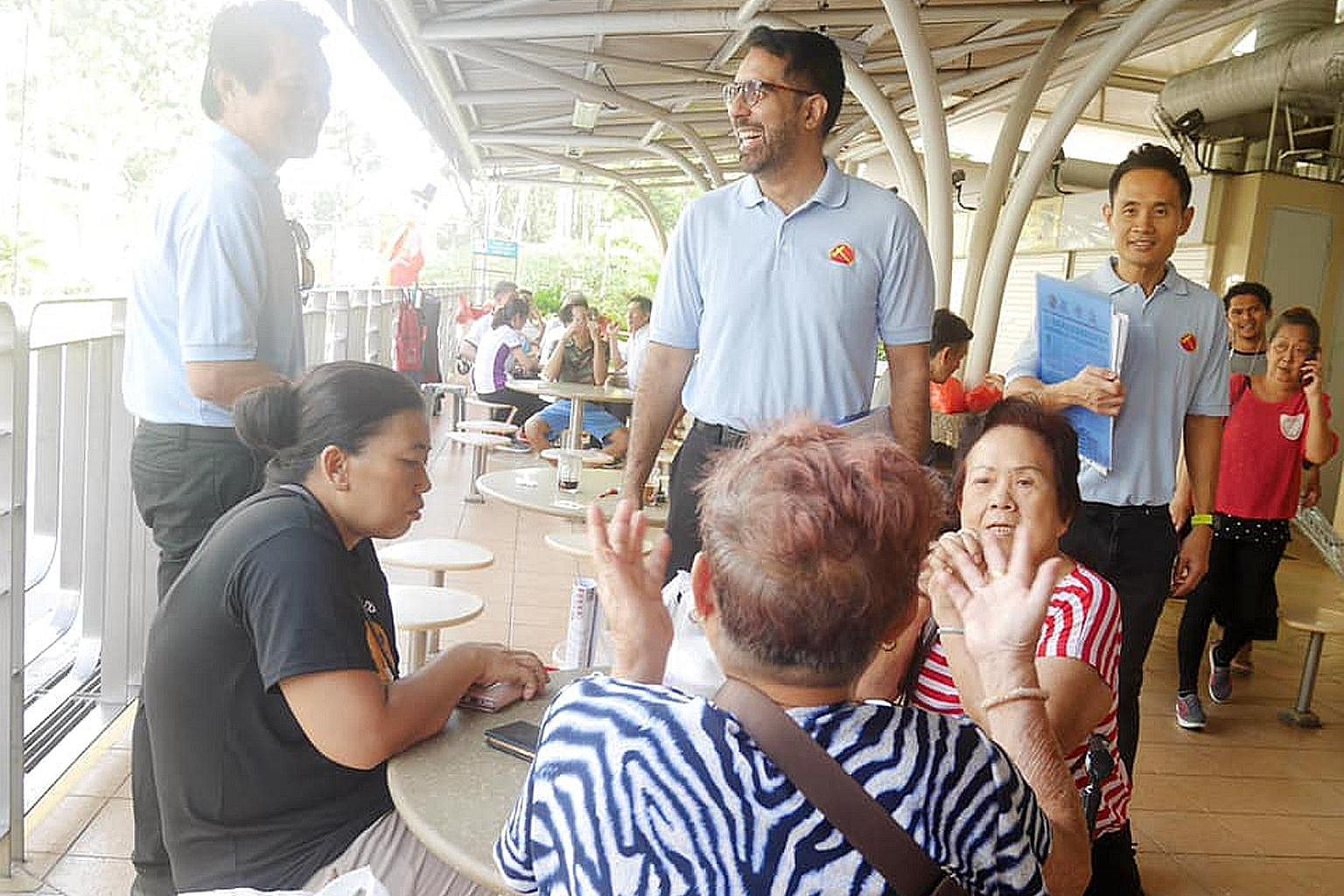 Workers' Party chief Pritam Singh (centre) and member Kenneth Foo (right) at the Eunos division of the WP-held Aljunied GRC earlier this month.