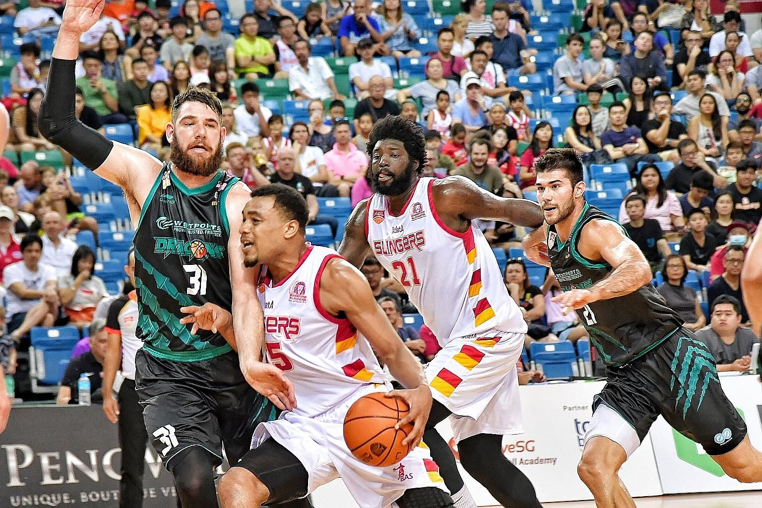 Slingers import players like Xavier Alexander (second from left), Anthony McClain (No. 21) and Jameel McKay (above) will return to the United States at the end of this month following the indefinite suspension of the ABL.