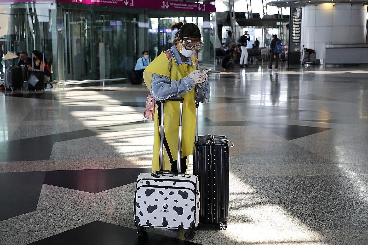 A well-protected traveller in a nearly empty Kuala Lumpur International Airport yesterday, the last day for Malaysians to leave the country, and for foreigners to enter before a restricted movement order that begins today.