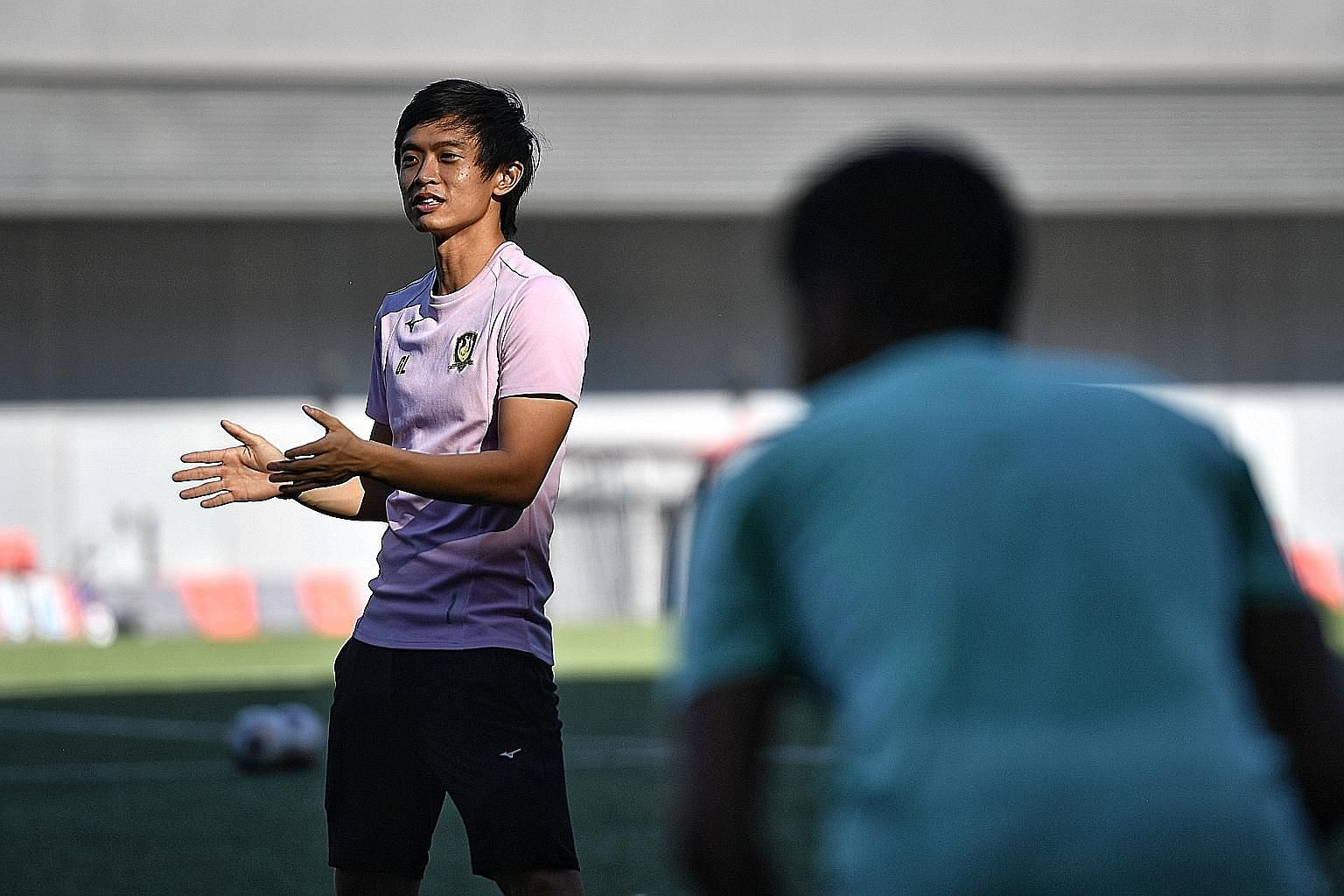 Tampines coach Gavin Lee is only 29 but despite being younger than some senior players, he has won them over with his commitment and tactics. ST PHOTO: ARIFFIN JAMAR