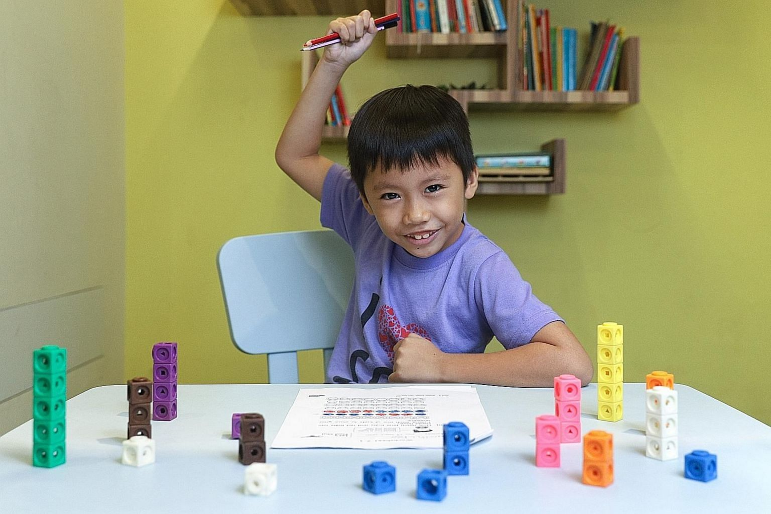 Kenneth Chow, six, could barely speak English when he arrived in Singapore two years ago from Indonesia, but is now fluent in the language, thanks to a programme by ReadAble. The volunteer group is part of national scheme ComLink, which provides proa