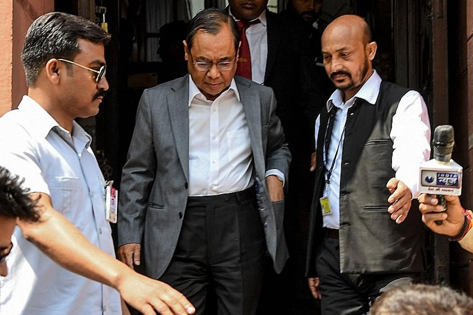 India's former Chief Justice Ranjan Gogoi (centre) leaving Parliament in New Delhi yesterday after taking his oath as a member of the Rajya Sabha or Upper House.