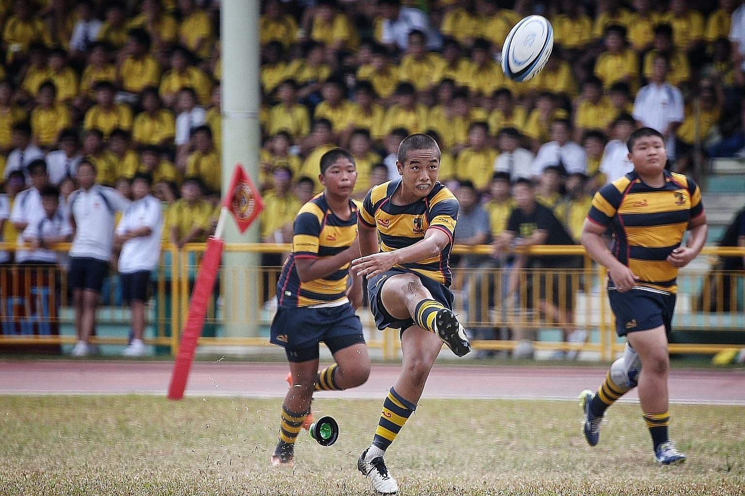 Anglo-Chinese School (Independent) player Tycen Yeoh kicking the ball during the C Division rugby final against St Andrew's last year. This year's National School Games have been suspended till after the June school holidays. ST FILE PHOTO