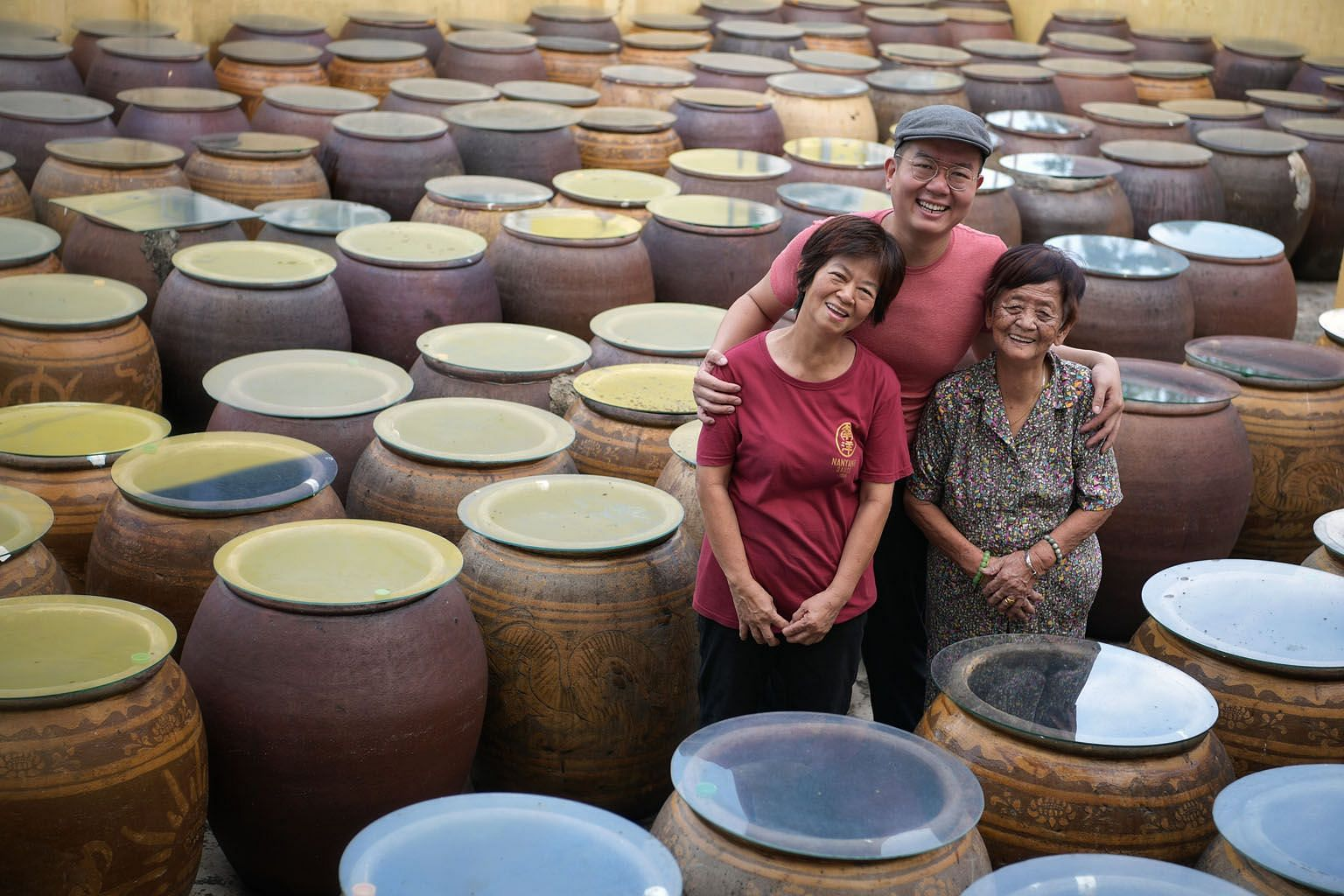 From left: Madam Tan Poh Choo, 63, a sauce master; Mr Ken Koh, 36; and Madam Ng Soh Lian, 94. The family-run Nanyang Sauce Factory, which has roots dating back to 1959, continues to pursue and uphold authentic soya sauce making traditions. Madam Ng,