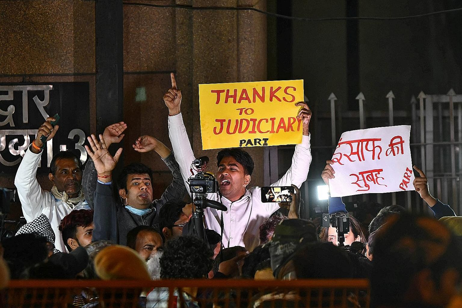 People celebrating outside the Tihar Jail in New Delhi after the four convicted rapists were hanged yesterday morning.
