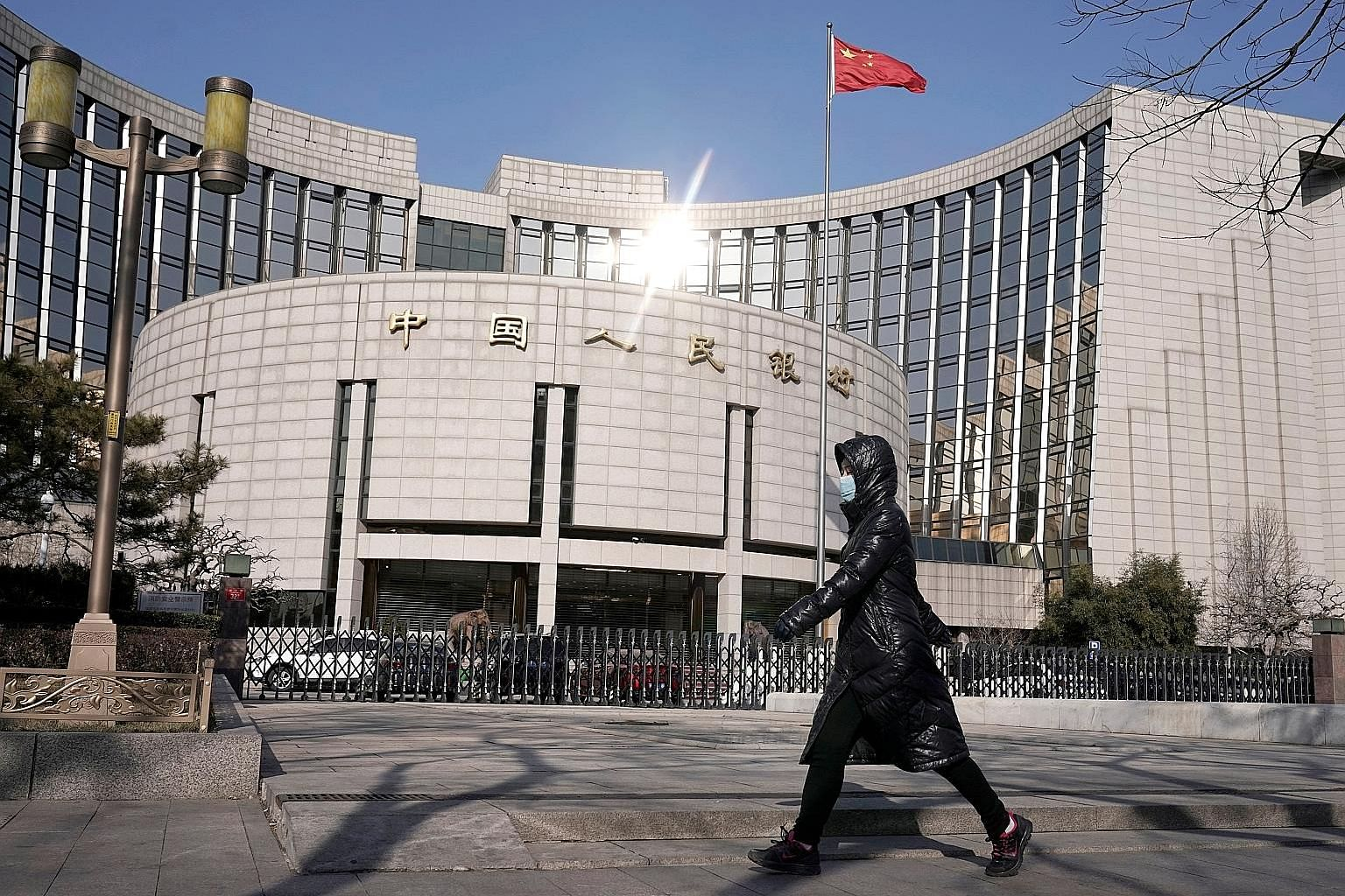 The headquarters of the People's Bank of China in Beijing. Analysts said the surprise non-action suggests the authorities in China are broadly comfortable with the current policy settings for now after the central bank last week cut the amount of res