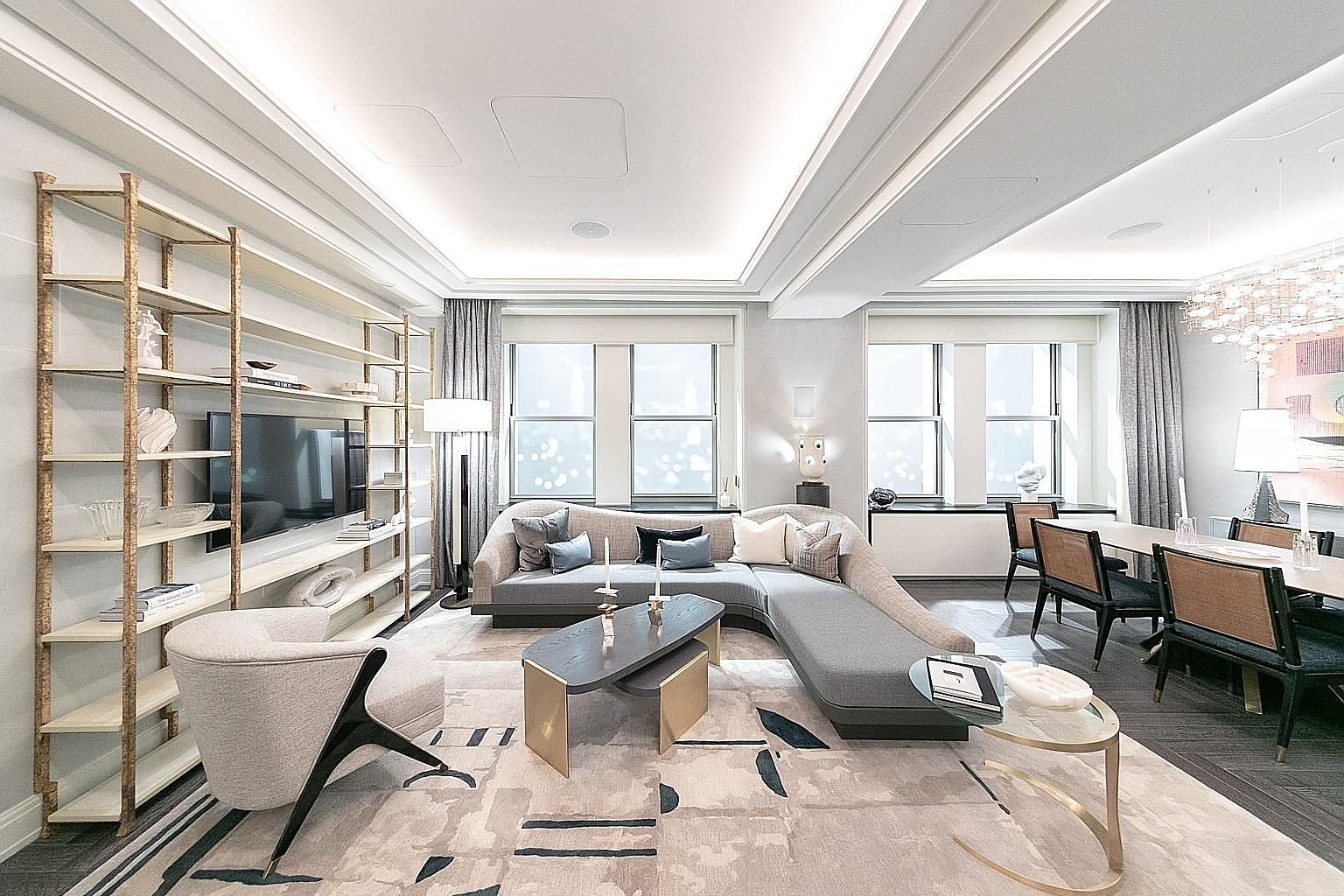 The living and dining room of a model apartment at the Towers of the Waldorf Astoria sales office in New York. The famed Art Deco hotel, sold for US$1.95 billion to China's Anbang Insurance in 2015, has been refurbished and partially converted into condom