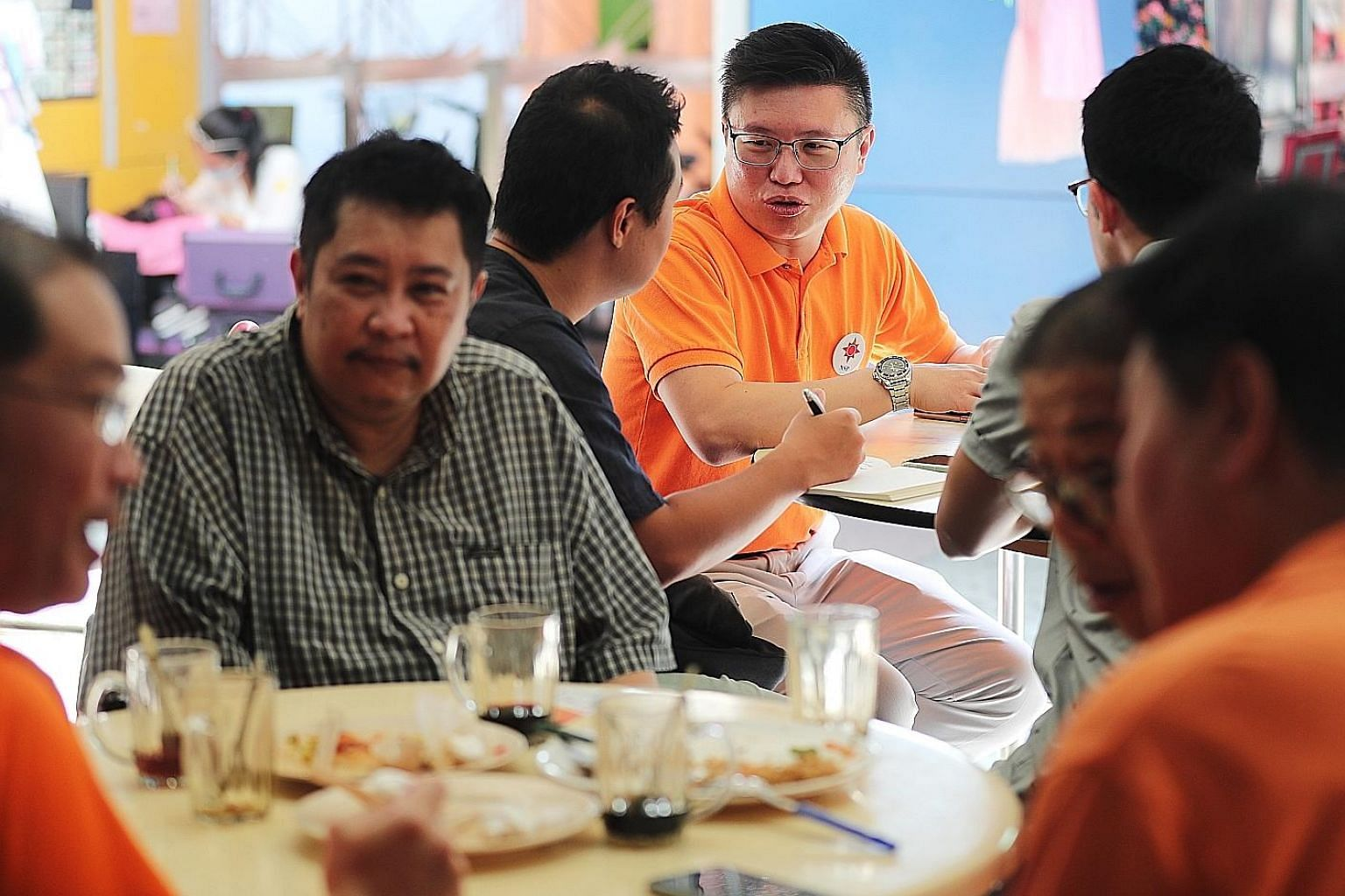 National Solidarity Party secretary-general Spencer Ng (centre), meeting the media in Tampines yesterday. He said his party will contest Tampines GRC, Sembawang GRC as well as Pioneer and MacPherson SMCs.