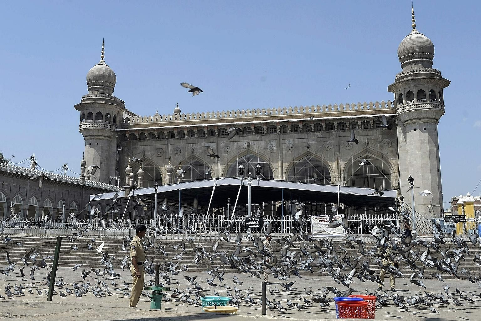 A policeman keeping watch outside Mecca Masjid in Hyderabad yesterday during a 14-hour nationwide curfew imposed to curb the spread of the coronavirus. PHOTO: AGENCE FRANCE-PRESSE