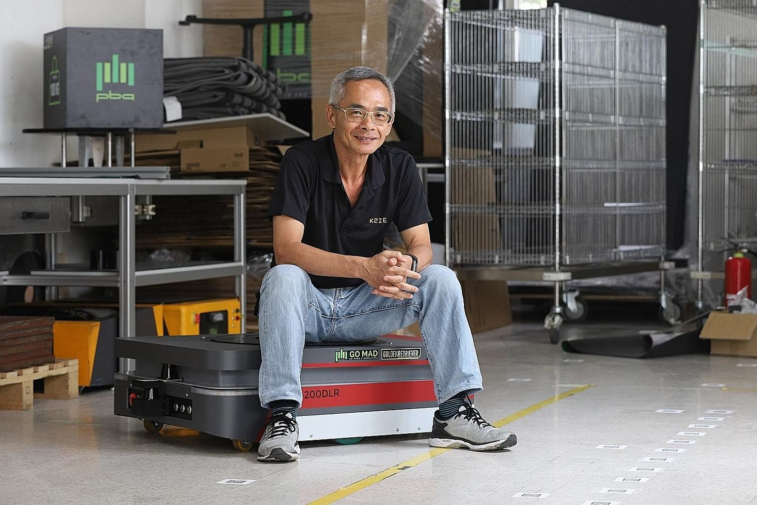 Mr Joseph Yap, a technical project manager at Kaze Robotics, with an automated guided vehicle which he has been working on.