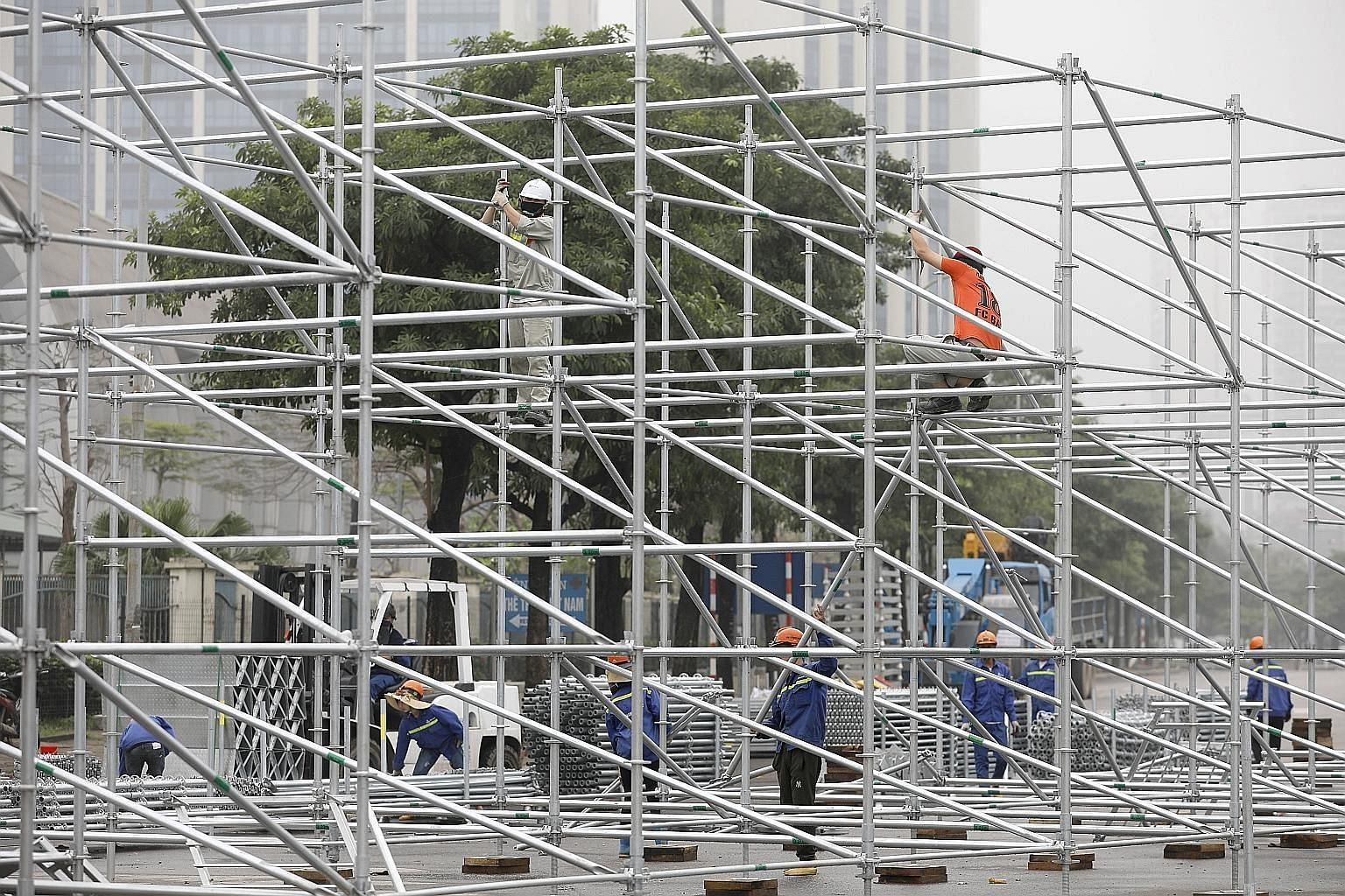 Builders uninstalling steel frames at the site of the Vietnam Grand Prix in Hanoi after the race was postponed indefinitely. It would have been the first F1 race in the country.