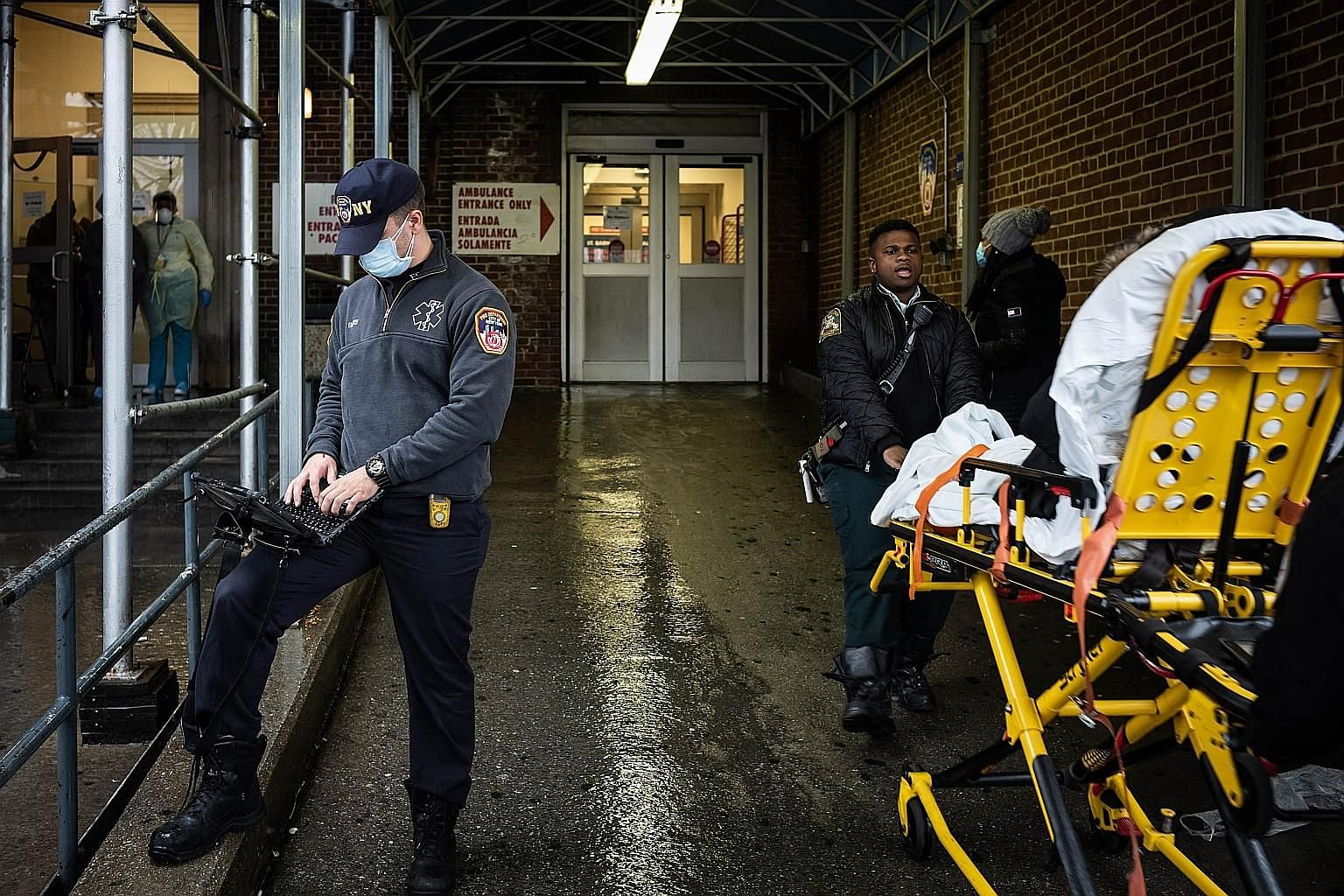Staff working outside the emergency department at St Barnabas Hospital in New York City on Monday. The writer urges millennials to take Covid-19 seriously as their social distancing is crucial to the health of more vulnerable populations and can have