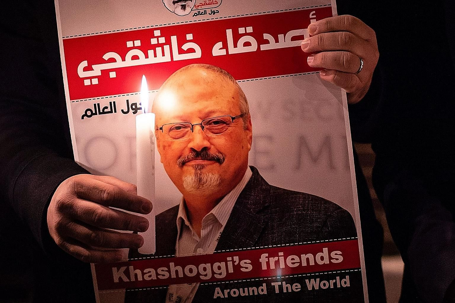 A poster of Mr Jamal Khashoggi seen at a gathering outside the Saudi consulate in Istanbul in 2018. The journalist's murder drew condemnation worldwide. PHOTO: AGENCE FRANCE-PRESSE