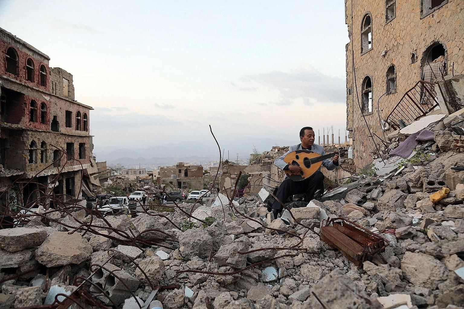 A man playing the oud amid rubble in the Yemeni city of Taez. Five years after launching its military intervention in Yemen, Saudi Arabia has failed to uproot Iran-backed Houthi rebels from their northern strongholds.