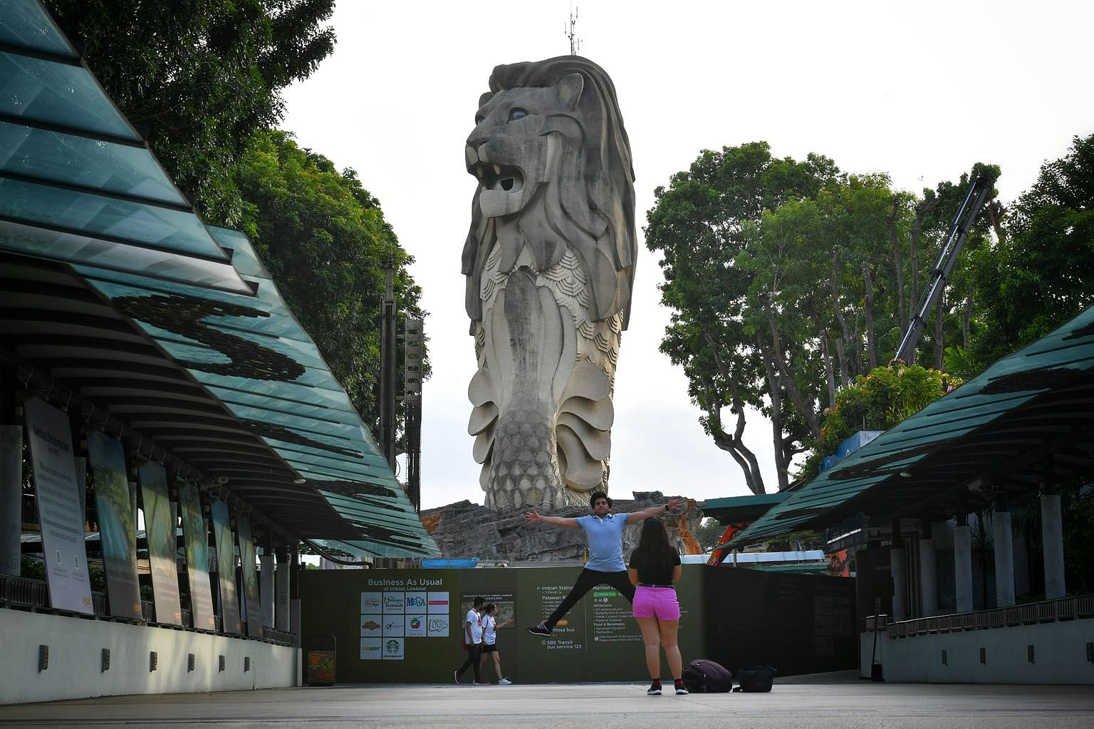 Visitors at Sentosa last month. Commercial properties more severely affected by the Covid-19 outbreak, including hotels, tourist attractions, shops and eateries, will not have to pay any property tax this year. ST PHOTO: CHONG JUN LIANG