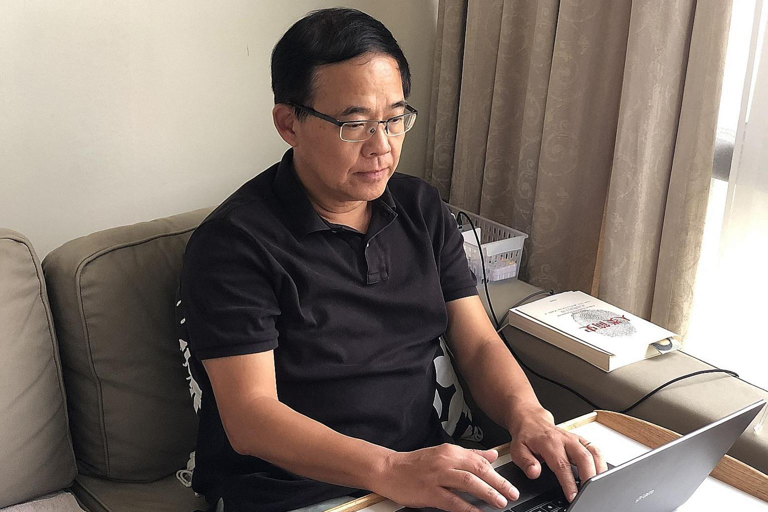 Professor Wang Linfa, director of the emerging infectious diseases programme at Duke-NUS Medical School, working at home while on self-imposed home quarantine after a visit to Wuhan, China.