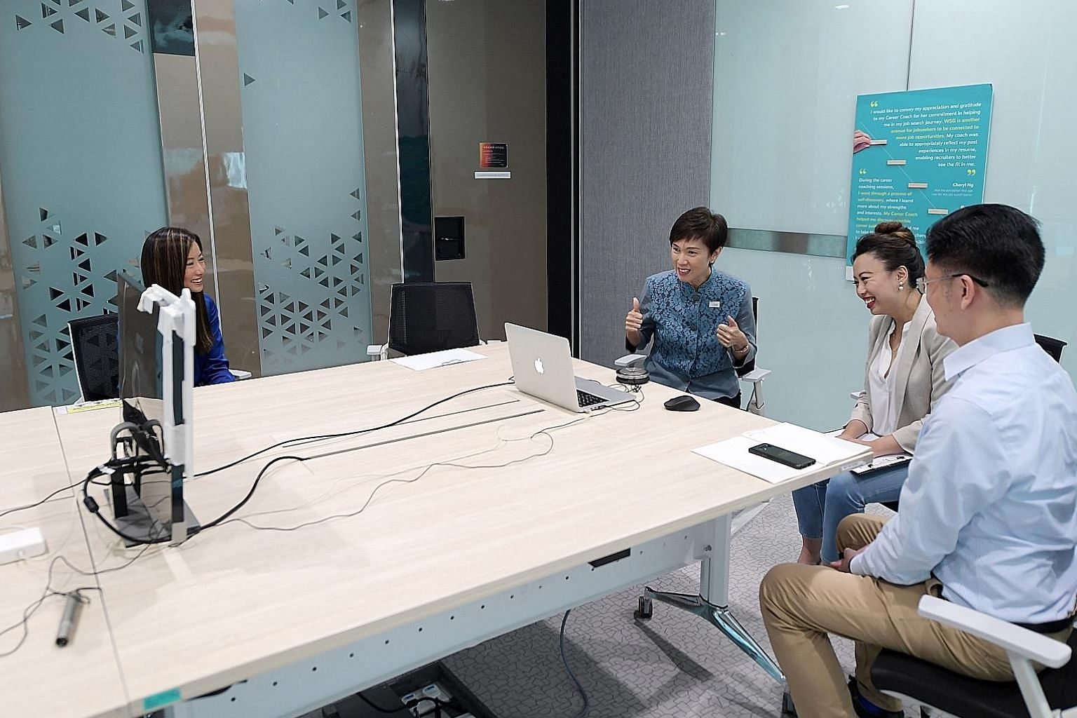 Manpower Minister Josephine Teo and School of Concepts director Mint Lim (second from right) interacting with jobseekers in a virtual networking session at Workforce Singapore's office yesterday, with Mr Chris Lau, senior career coach at WSG's career