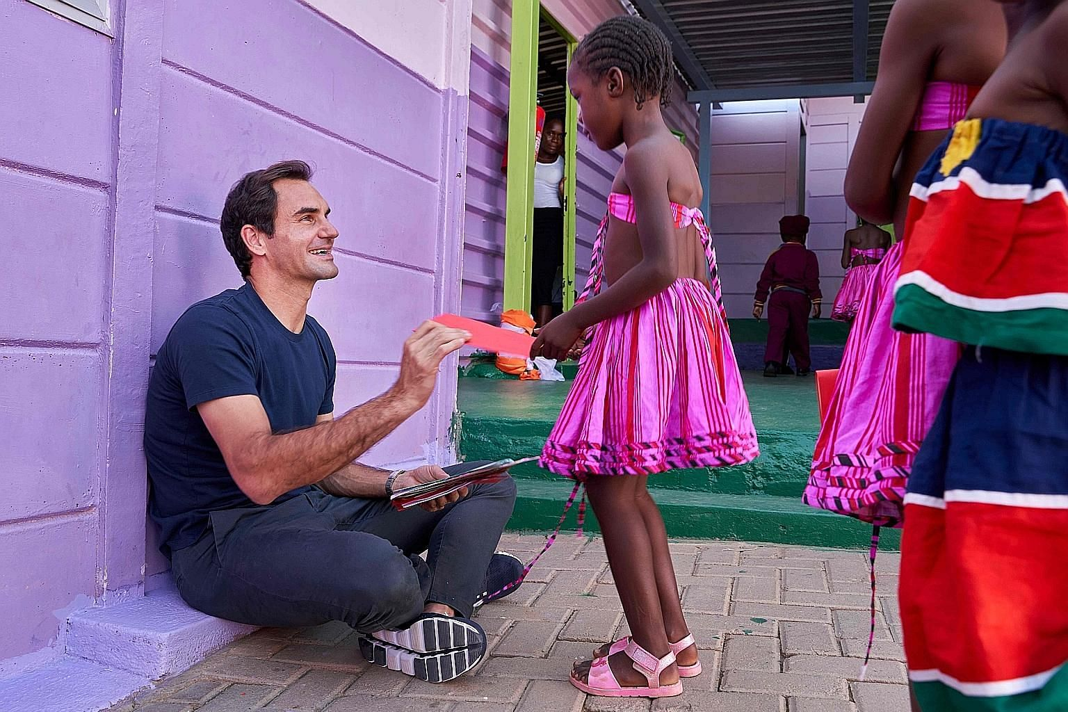 Roger Federer sharing a smile with a young beneficiary of the Roger Federer Foundation in Windhoek, Namibia, last month. Federer visited Namibia en route to his exhibition match in Cape Town against Rafael Nadal.