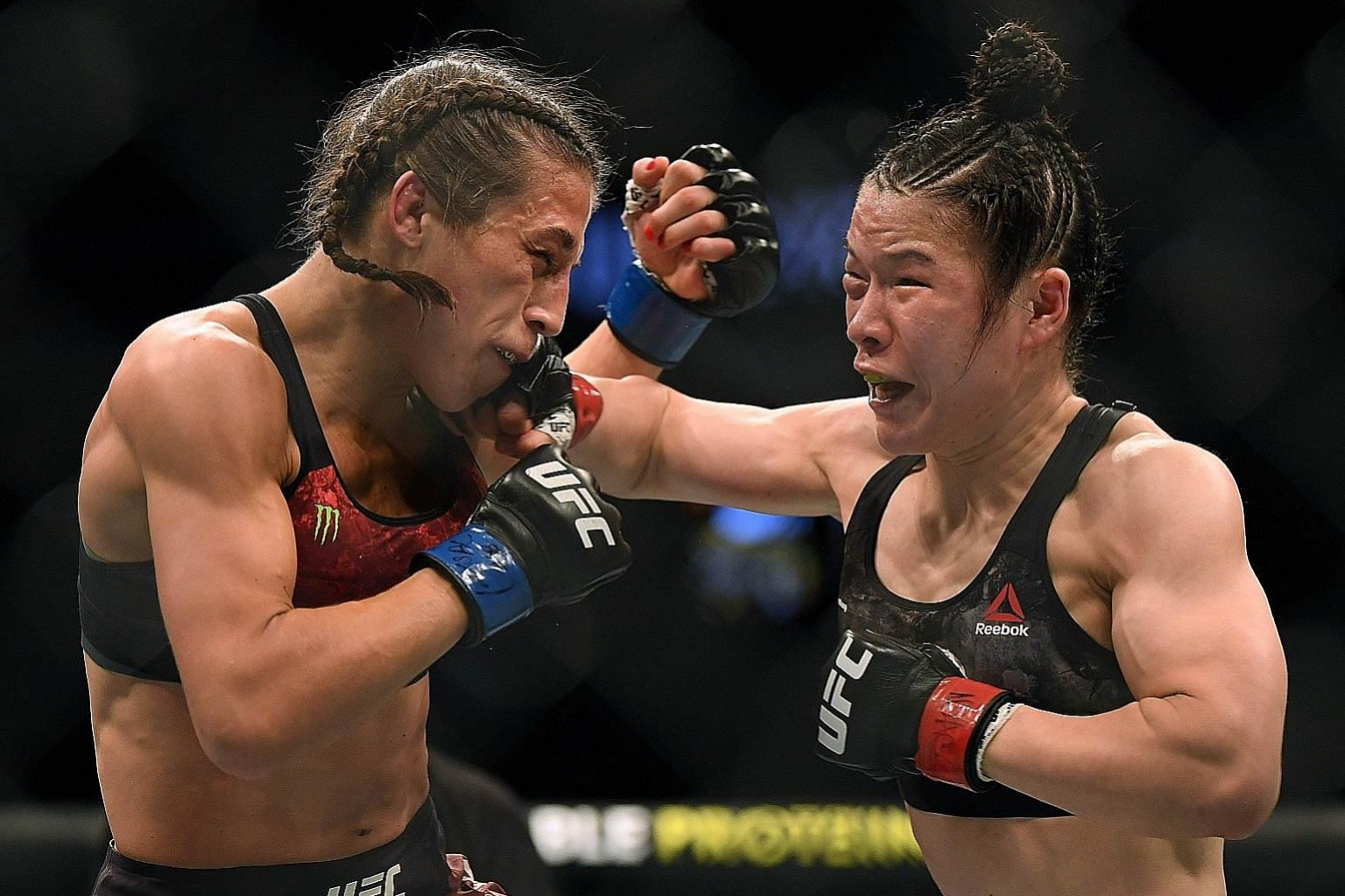 Zhang Weili punching Joanna Jedrzejczyk on her way to a split-decision win earlier this month in Las Vegas, Nevada.
