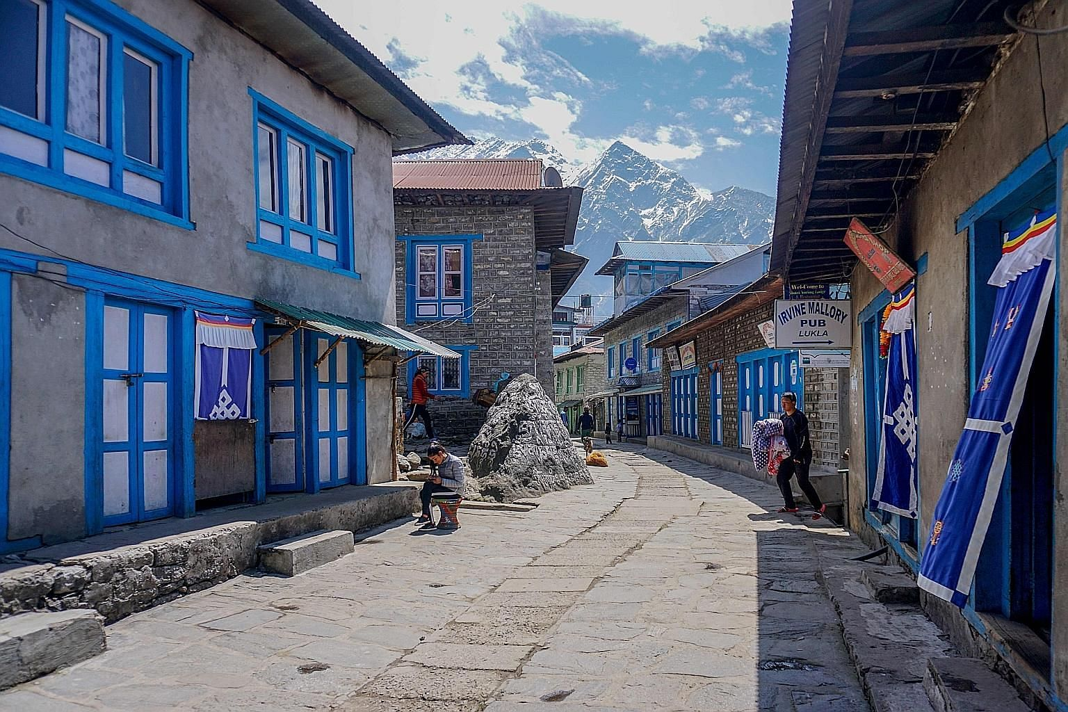Closed shops and restaurants along an almost deserted street in Lukla, the main gateway to the Everest region in Nepal, during a government-imposed nationwide lockdown as a preventive measure against the coronavirus yesterday. Foreign governments on