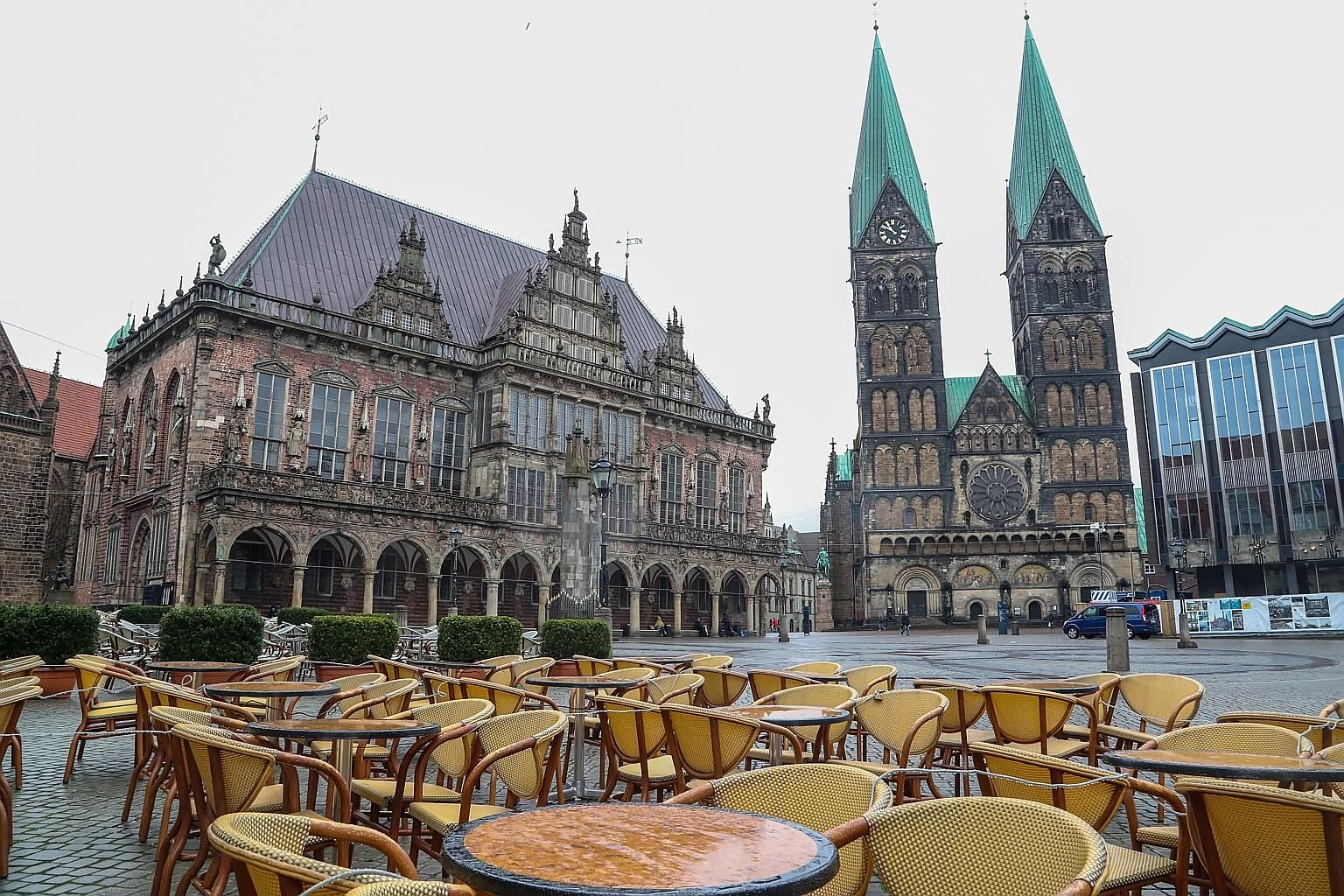 An empty cafe in a nearly deserted square in Bremen, Germany, on March 19. The effects of the coronavirus pandemic mean that hundreds of thousands of small businesses that were flourishing only two weeks ago are now suffering the anguish of having no