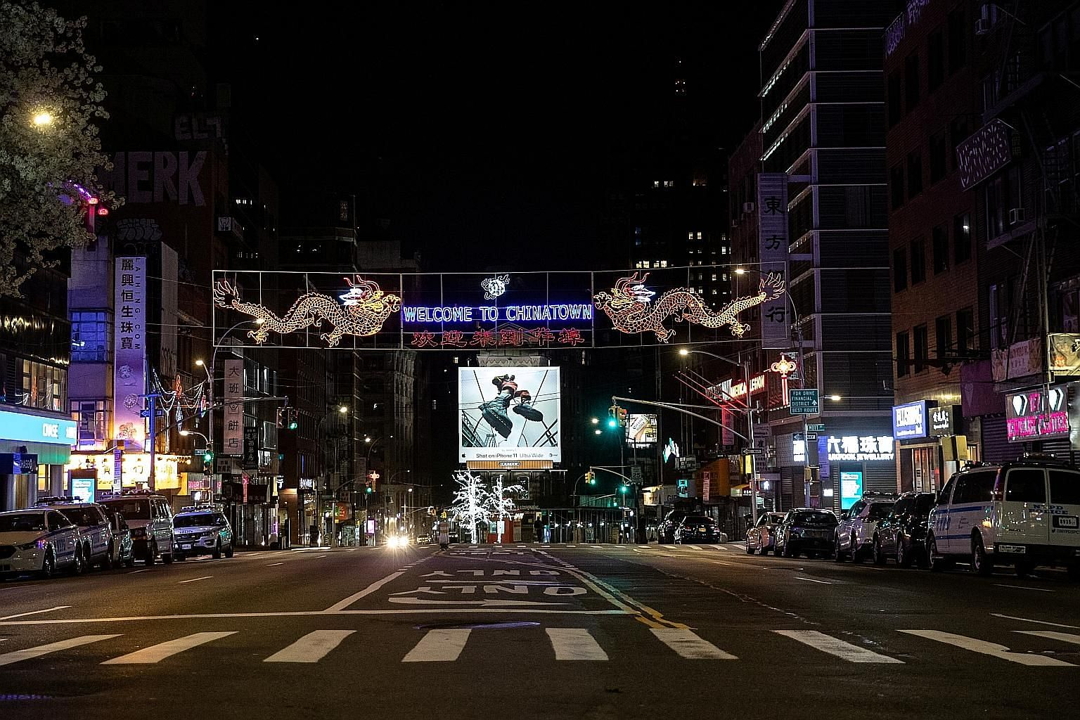 """A quiet street near Chinatown in Manhattan, New York City, last Friday. Public health officials have been talking about the value of social distancing measures as a way to """"flatten the curve"""" of the epidemic. New York's current infection growth rate"""