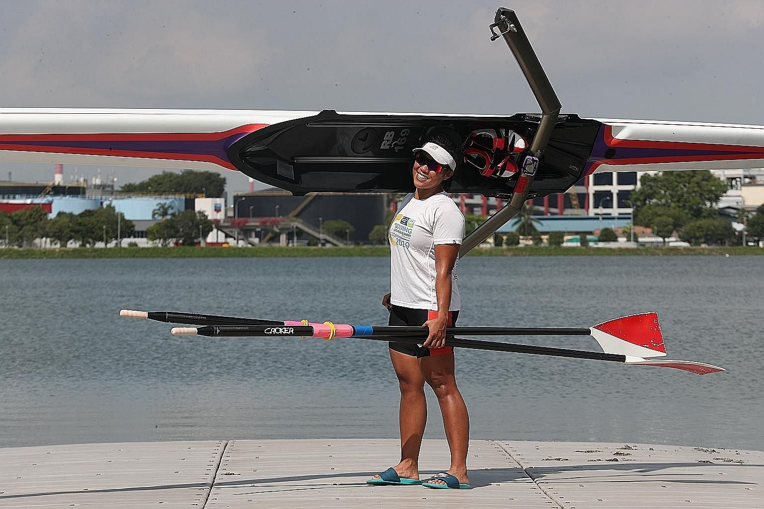 Qualifying for the Olympics consumes Joan Poh. It has led her to empty her savings, buy her own boat for $18,000, travel to multiple nations and hunt for coaches. ST PHOTO: TIMOTHY DAVID