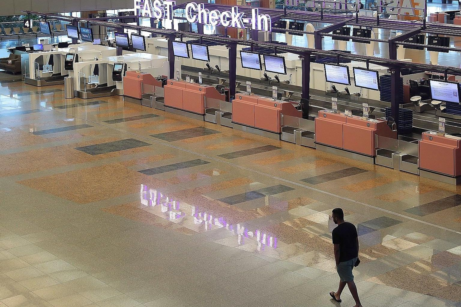 An almost-deserted Changi Airport Terminal 2 last Tuesday, due to a large number of cancelled flights. In the wake of the virus outbreak, cities and countries have closed their borders and people are staying home.